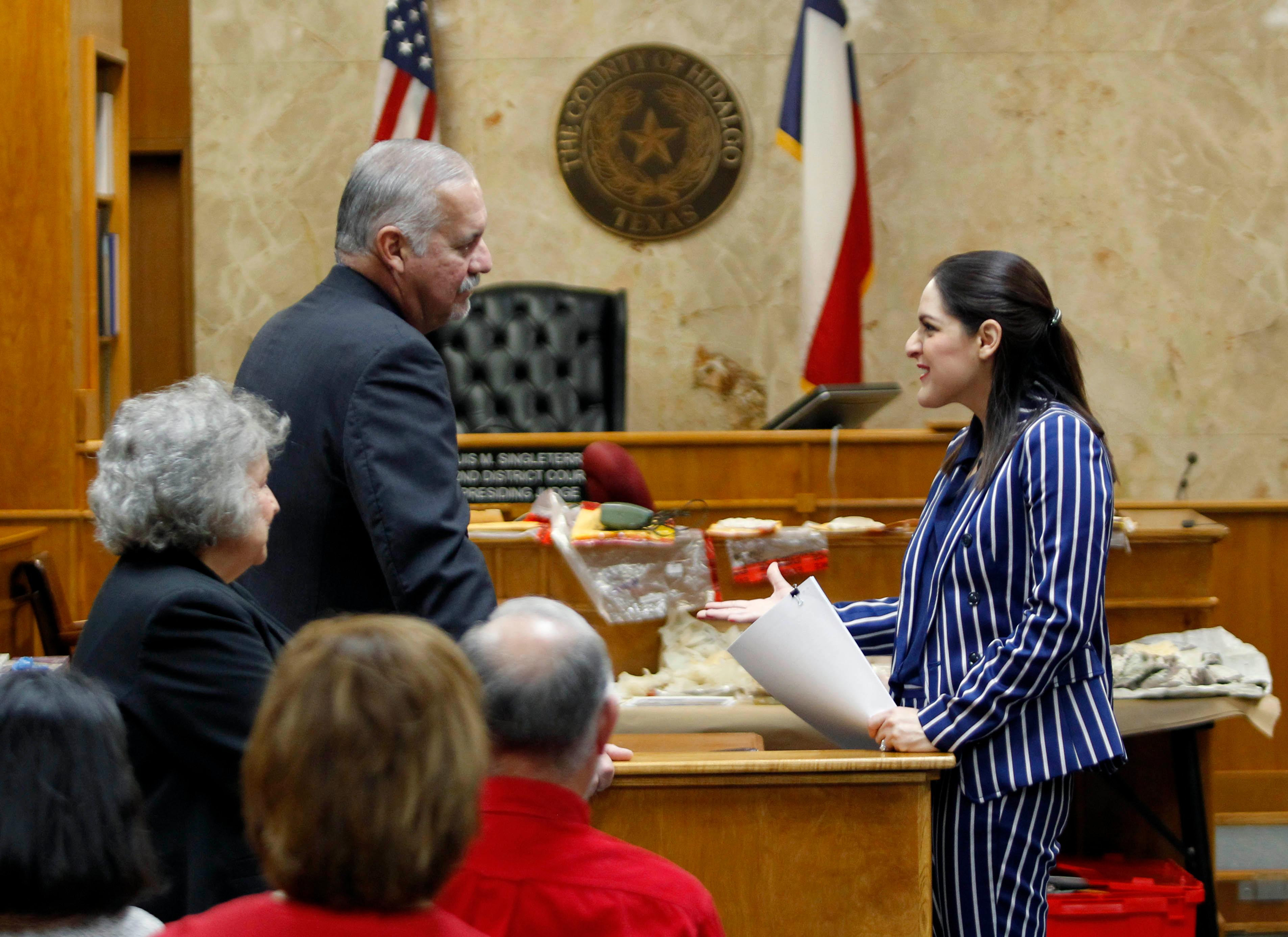 Defense attorney A. Ricardo Flores talks with Hidalgo County Assistant District Attorney Kristine Ramos before the start of the fifth day of John Bernard Feit's trial for the 1960 murder of Irene Garza Wednesday, December 6, 2017, at the Hidalgo County Courthouse in Edinburg.                 (Nathan Lambrecht/The Monitor/Pool)