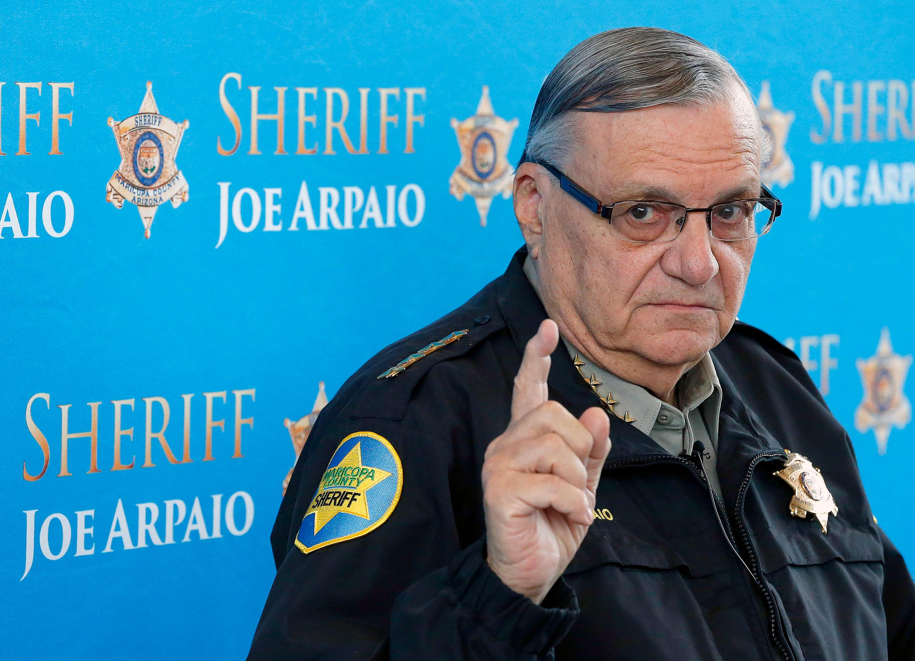 FILE - In this Dec. 18, 2013 file photo, Maricopa County Sheriff Joe Arpaio pauses as he answers a question at a news conference at Maricopa County Sheriff's Office Headquarters in Phoenix. Arpaio was convicted of a criminal charge Monday, July 31, 2017, for refusing to stop traffic patrols that targeted immigrants, marking a final rebuke for a politician who once drew strong popularity from such crackdowns but was ultimately booted from office as voters became frustrated over his headline-grabbing tactics and deepening legal troubles. (AP Photo/Ross D. Franklin, File)