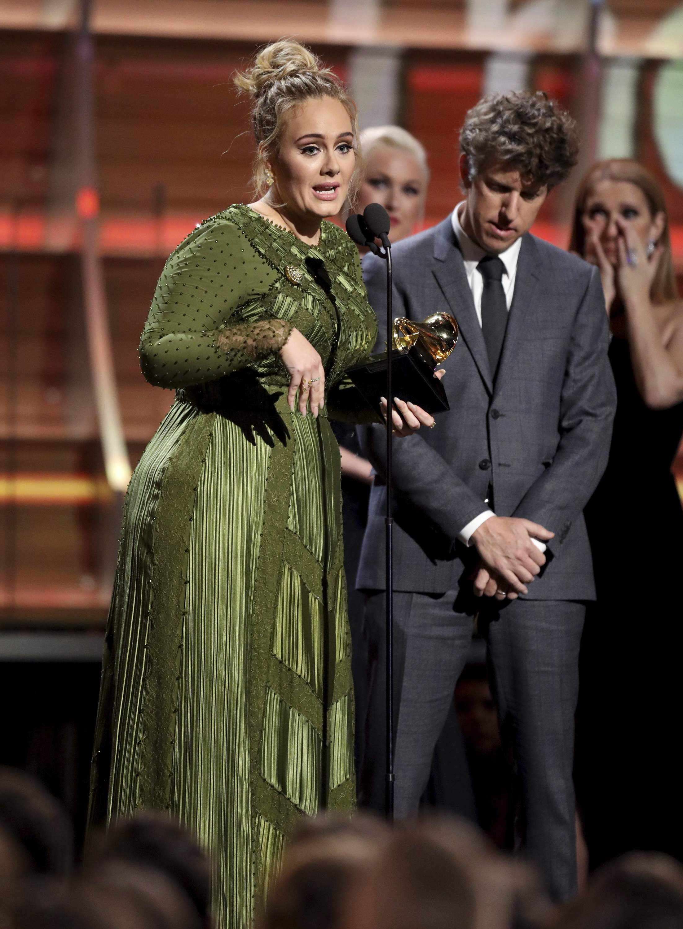 Adele accepts the award for song of the year for 'Hello' at the 59th annual Grammy Awards on Sunday, Feb. 12, 2017, in Los Angeles. THE ASSOCIATED PRESS
