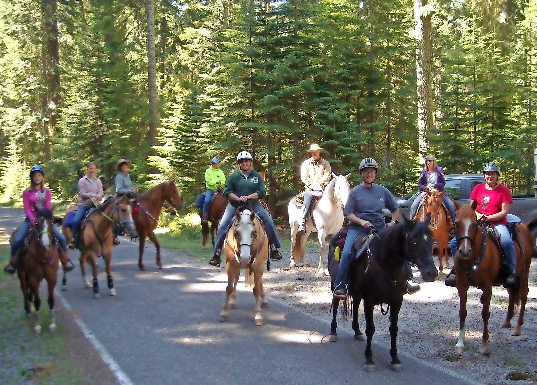 Club members gather for a trail ride on Brown Mountain. - Photo by Cindy Marotta