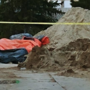 Crews unable to pull man's body from collapsed trench, police will guard scene overnight