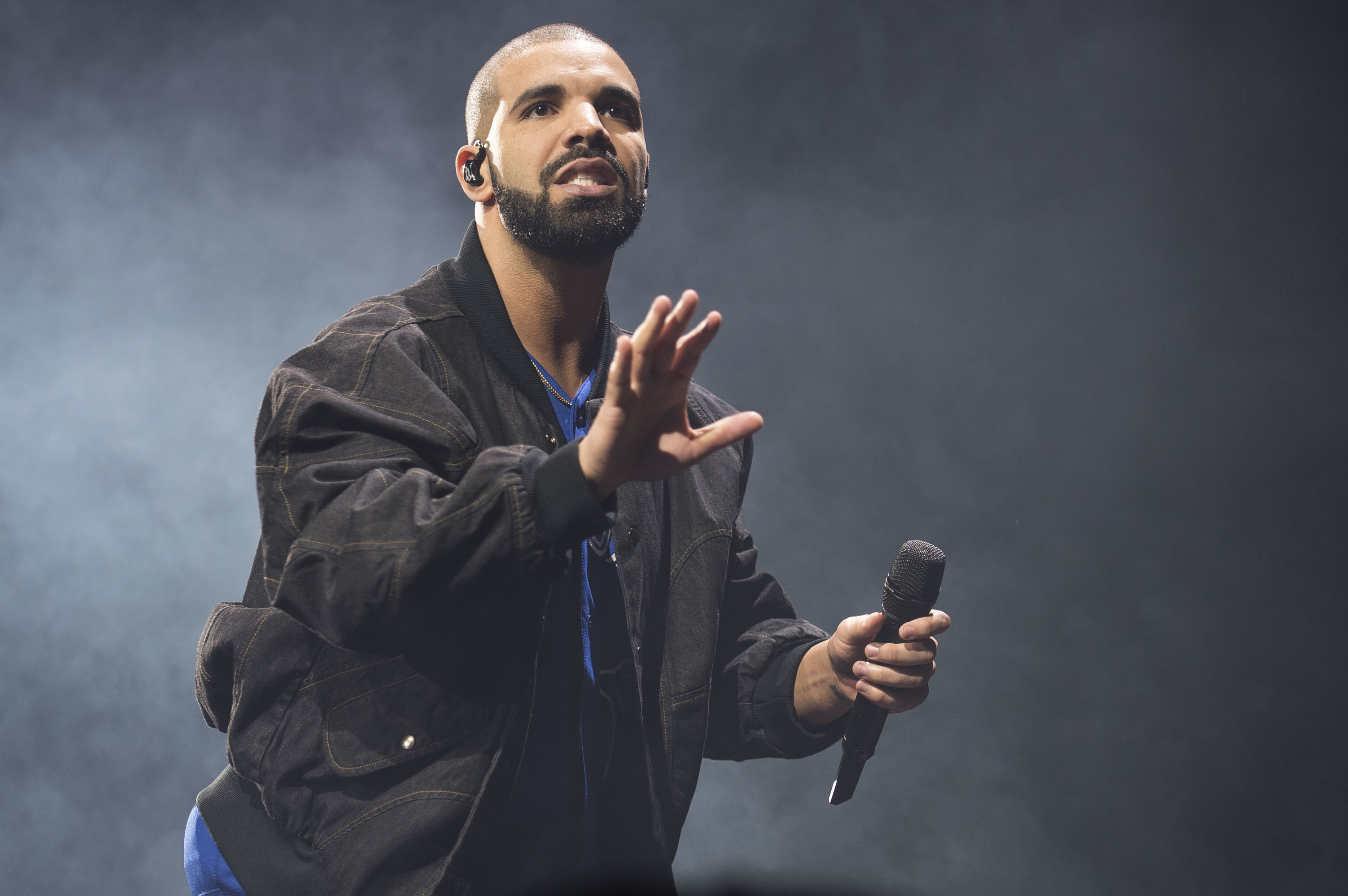FILE - In this Oct. 8, 2016 file photo, Drake performs onstage in Toronto. Authorities say an intruder was arrested at Drake's Southern California house, but the woman apparently did nothing but drink the rapper's water and soda pop. The Los Angeles County Sheriff's Department says deputies from its Malibu/Lost Hills Station arrested 24-year-old Mesha Collins Monday, April 17, 2017, inside the home of Drake, whose real name is Aubrey Graham.  (Photo by Arthur Mola/Invision/AP, File)