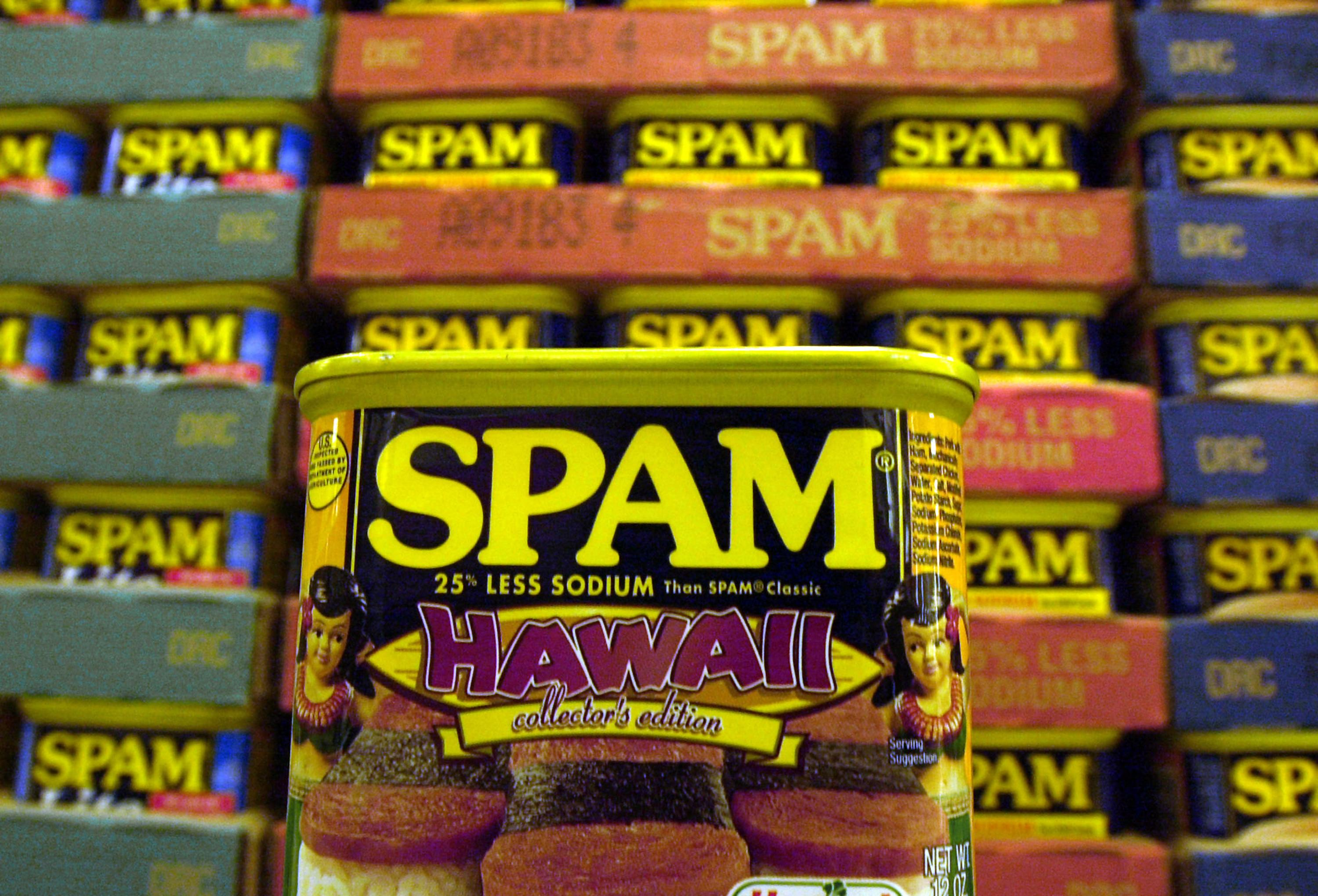 "FILE - This March 3, 2004 file photo shows a collector's limited edition ""Hawaii"" can of Spam, with a hula doll on both sides of the can and a picture of three pieces of spam musubi in Kailua, Hawaii. (AP Photo/Lucy Pemoni, File)"
