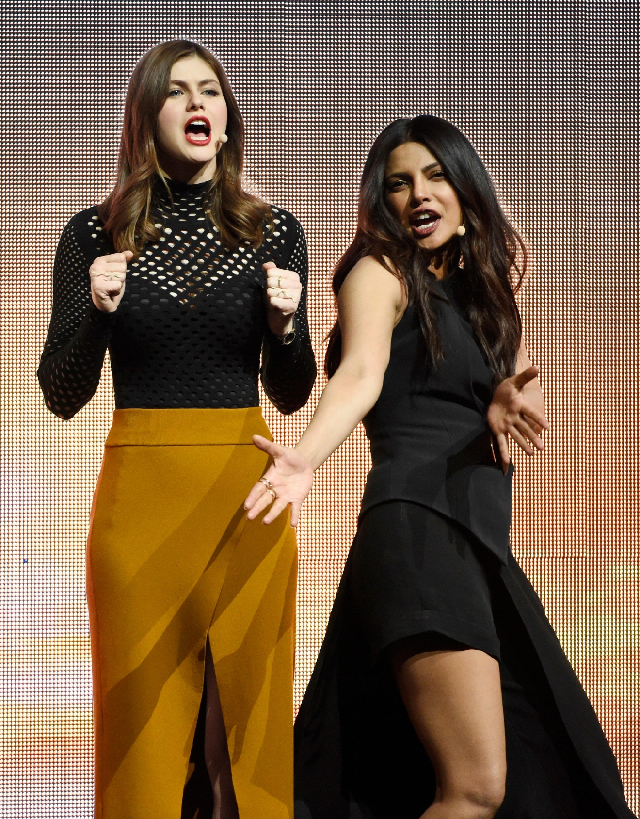 "Alexandra Daddario, left, and Priyanka Chopra, cast members in the upcoming film ""Baywatch,"" react to the audience during the Paramount Pictures presentation at CinemaCon 2017 at Caesars Palace on Tuesday, March 28, 2017, in Las Vegas. (Photo by Chris Pizzello/Invision/AP)"