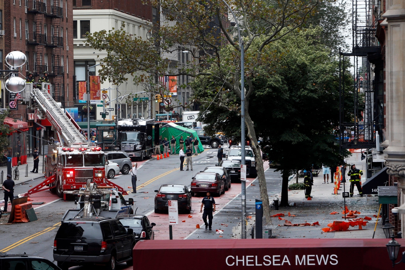 Emergency personnel work at the scene of Saturday's explosion on West 23rd Street in Manhattan's Chelsea neighborhood, Monday, Sept. 19, 2016, in New York. (AP Photo/Jason DeCrow)