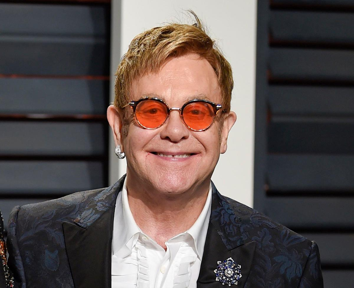 FILE - In this Feb. 27, 2017 file photo, Elton John arrives at the Vanity Fair Oscar Party in Beverly Hills, Calif.  Elton John announced Wednesday, Jan. 24, 2018 that his upcoming tour will be his last. (Photo by Evan Agostini/Invision/AP, File)