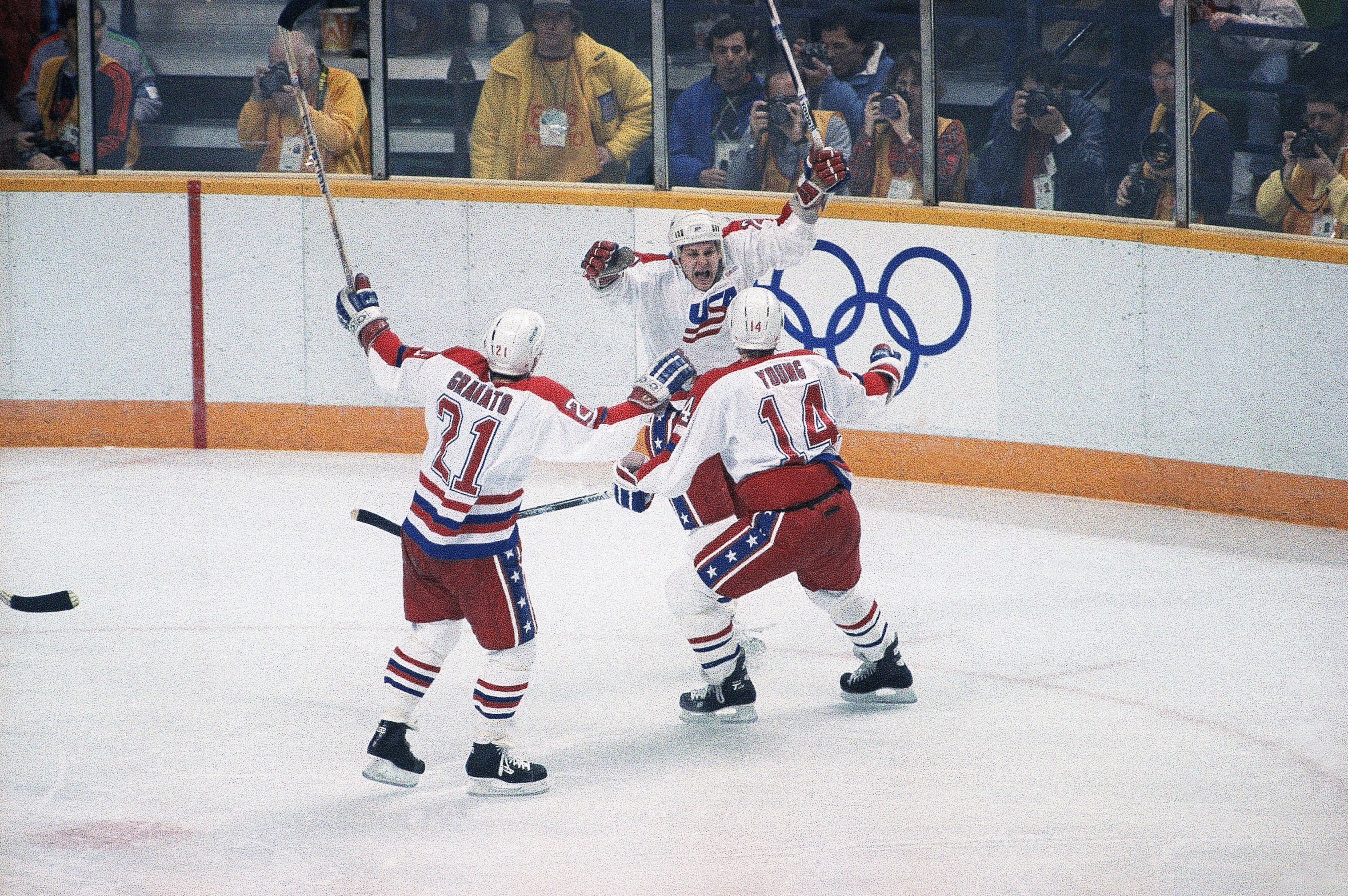 FILE - In this Feb. 15, 1988, file photo, Craig Millen of the United States heads for the arms of teammates Tony Granato (21) and Scott Young (14) after he scored a goal in the first period of a hockey game against Czechoslovakia at the Winter Olympics in Calgary. The 2018 Winter Games in Pyeongchang, South Korea will present a much different situation from any previous Olympic men's hockey tournament in history. USA Hockey general manager Jim Johannson said his team won't play any exhibition games with most U.S. players arriving in South Korea on Feb. 8. Johannson said the U.S. will practice Feb. 10-13 and get in a game-day skate Feb. 14, which coach Tony Granato feels will be enough preparation. (AP Photo/Steve Simon, File)