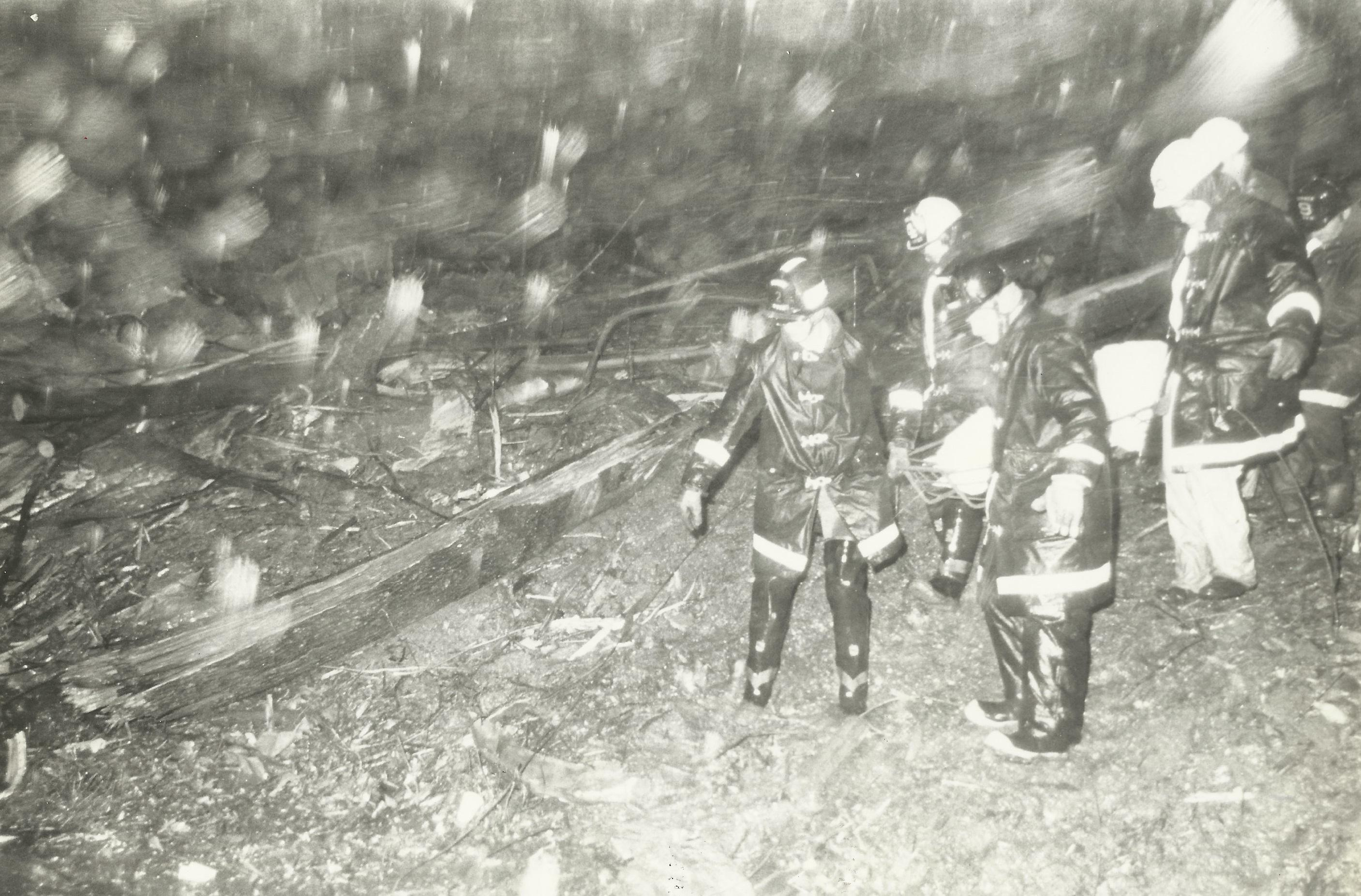 Crews from Loudoun County Fire Department searching for any possible survivors less than an hour after the crash of TWA 514. Snow began to fall at sundown, making their efforts even more challenging. (Photo courtesy of Oliver Dube)