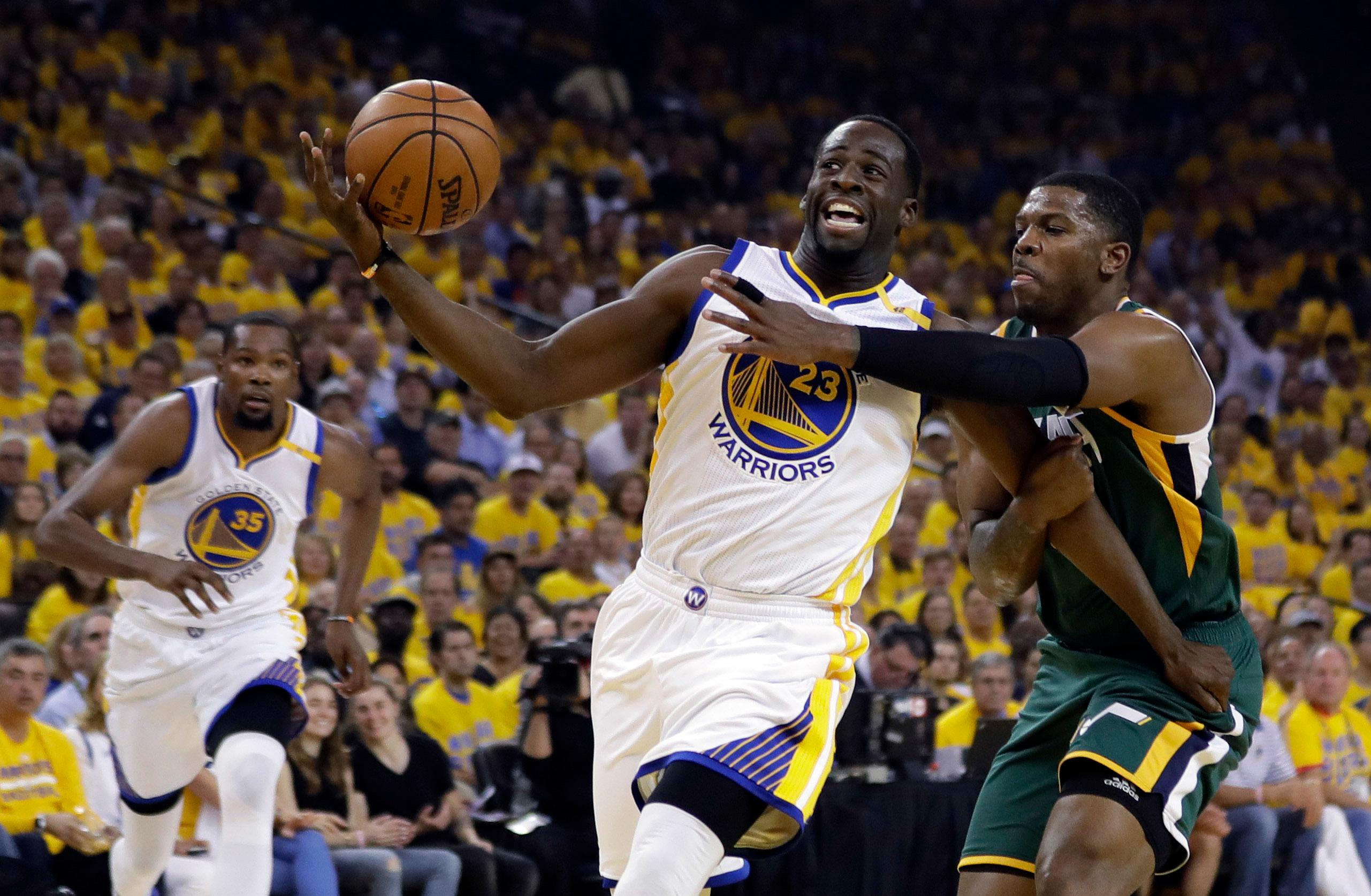 Golden State Warriors forward Draymond Green (23) is fouled by Utah Jazz forward Joe Johnson, right, during the first half in Game 1 of an NBA basketball second-round playoff series, Tuesday, May 2, 2017, in Oakland, Calif. (AP Photo/Marcio Jose Sanchez)