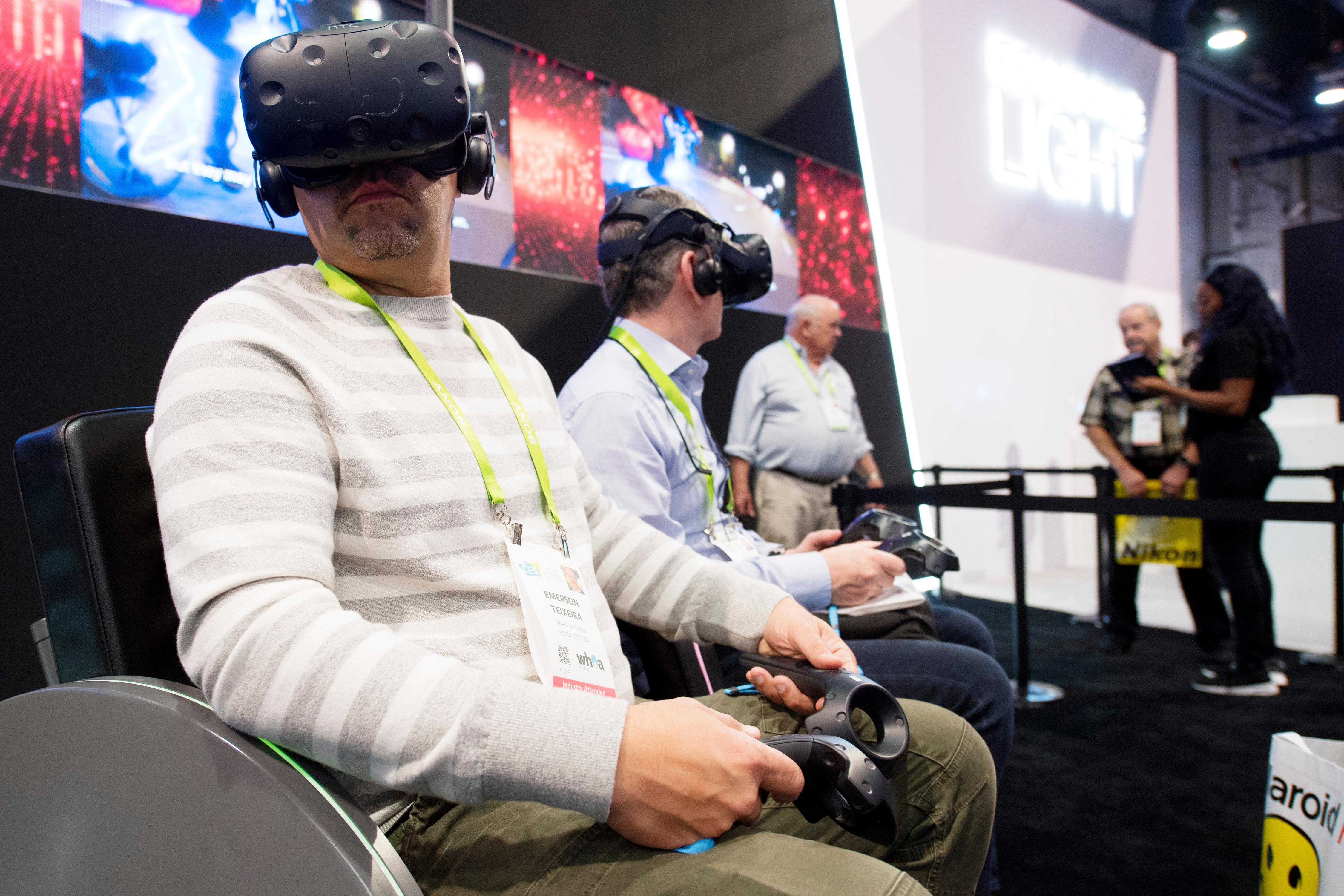 Attendees check out virtual reality offerings during the second day of CES Wednesday, January 10, 2018, at the Las Vegas Convention Center. CREDIT: Sam Morris/Las Vegas News Bureau