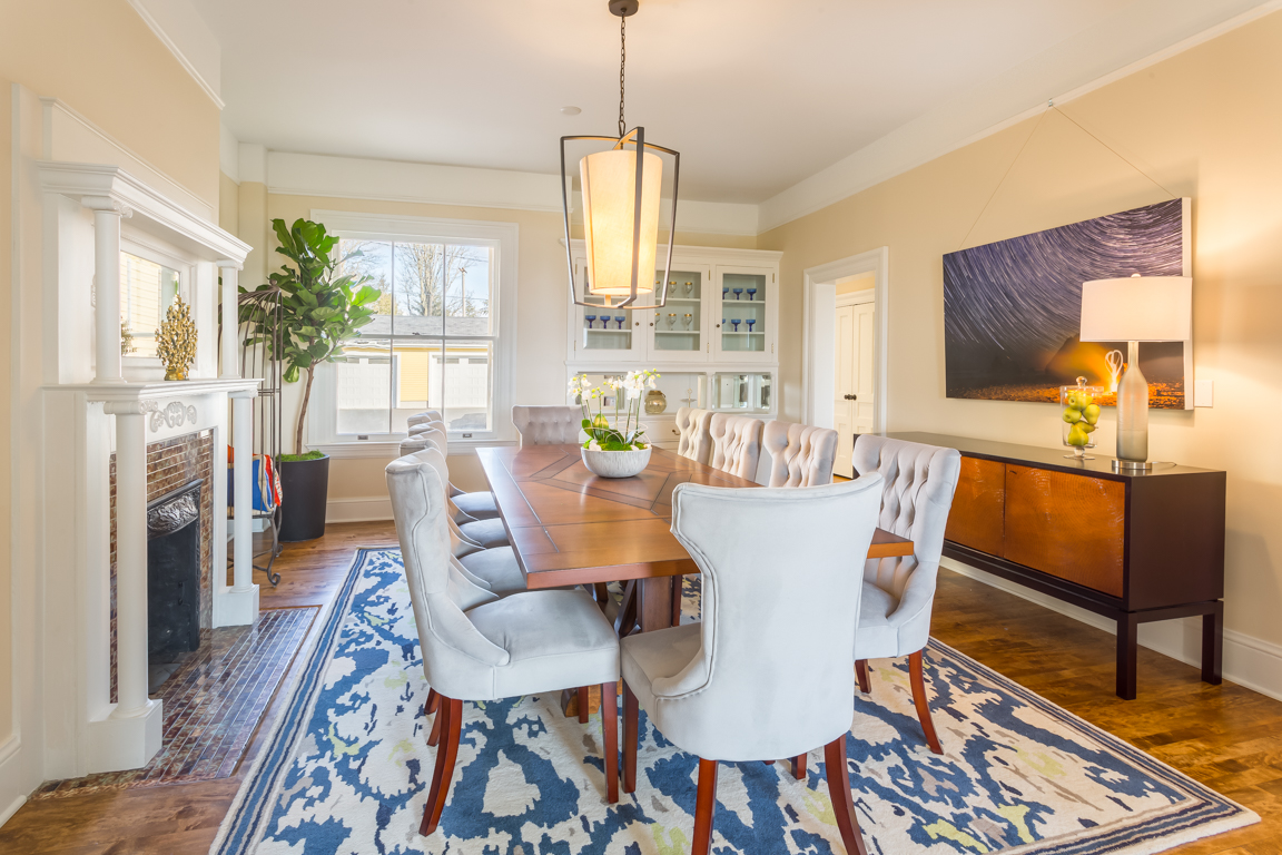The formal dining room of the Frederick is ready for entertaining. Featuring the original fireplace, windows and the original built-in cabinet hutch.