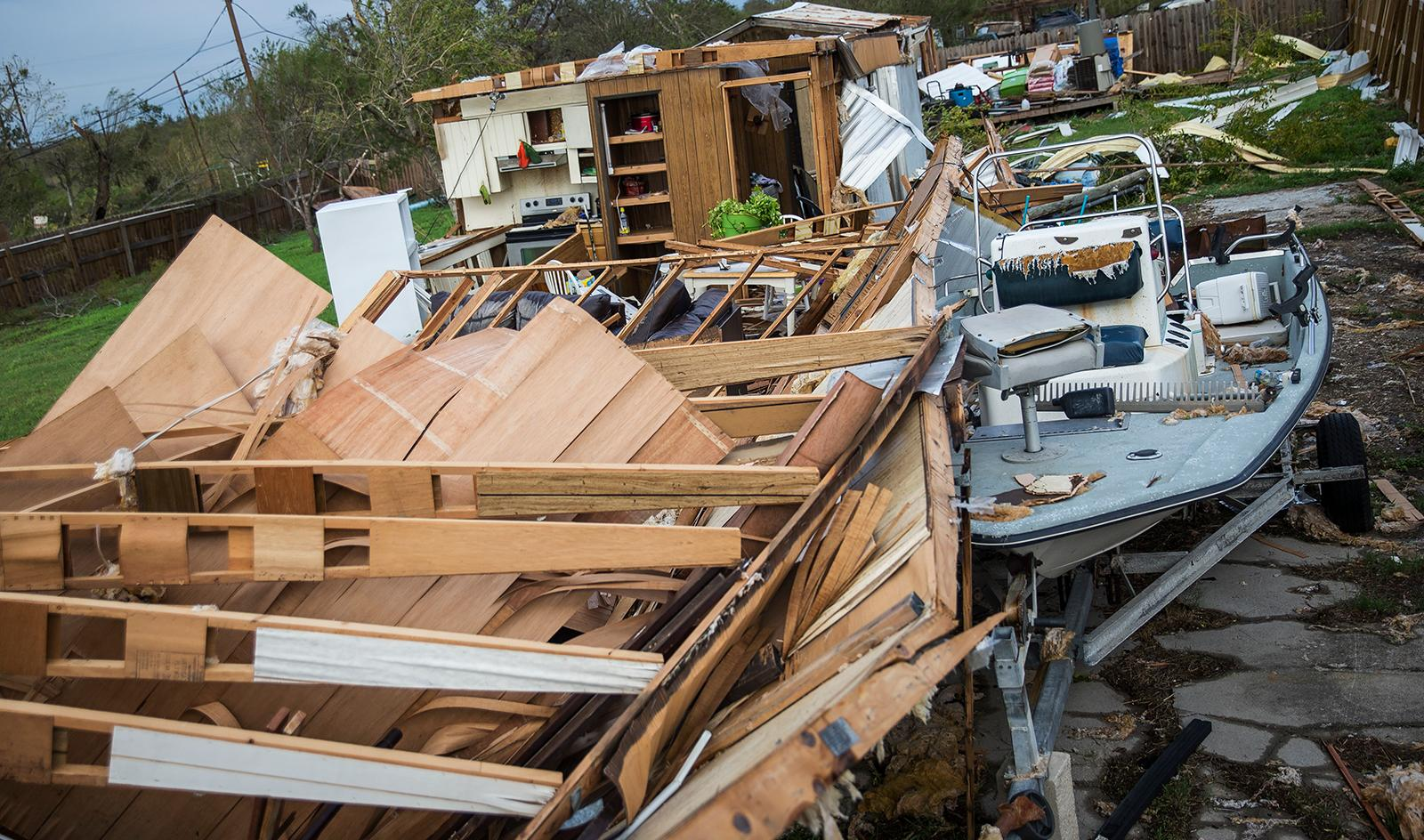 Debris is scattered around a trailer home in the wake of Hurricane Harvey in Refugio, Texas, Monday, Aug. 28, 2017. (Nick Wagner/Austin American-Statesman via AP)