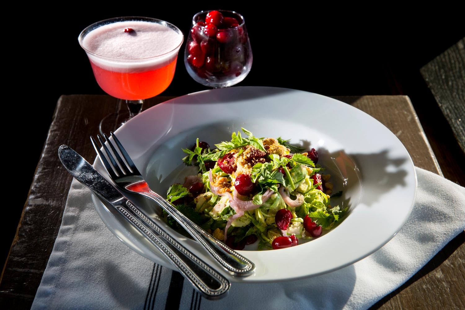 The brussels sprout salad, with raw brussels sprouts, cranberries, hazelnuts, topped with citrus vinaigrette, at Pickled Fish, located at 409 Sid Snyder Dr, Long Beach, WA. (Sy Bean / Seattle Refined)