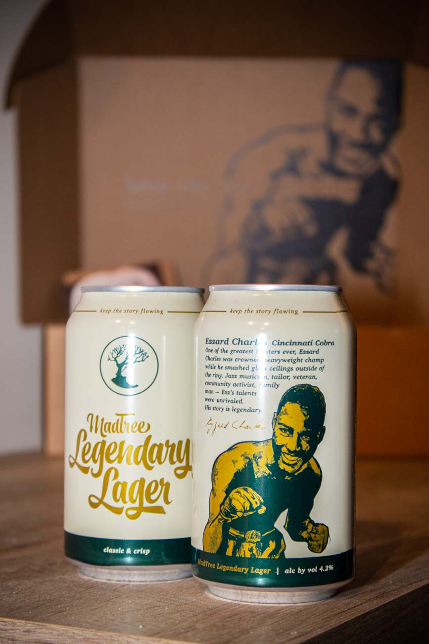 "<p>Artist Jason Snell did the illustrations on the lager. He also helped create the ""Legend Mural Series"" with Artworks and has designed, illustrated, and helped produce local murals including the Heavyweight Champion Boxer Ezzard Charles mural in Over-the-Rhine. He's currently in the works on an interactive bronze sculpture featuring Ezzard Charles in West End's Laurel Park. You can learn more about him and his works on his{&nbsp;}<a  href=""https://www.instagram.com/jasonsnell/"" target=""_blank"" title=""https://www.instagram.com/jasonsnell/"">Instagram</a>. / Image: Katie Robinson, Cincinnati Refined // Published: 2.27.21</p>"