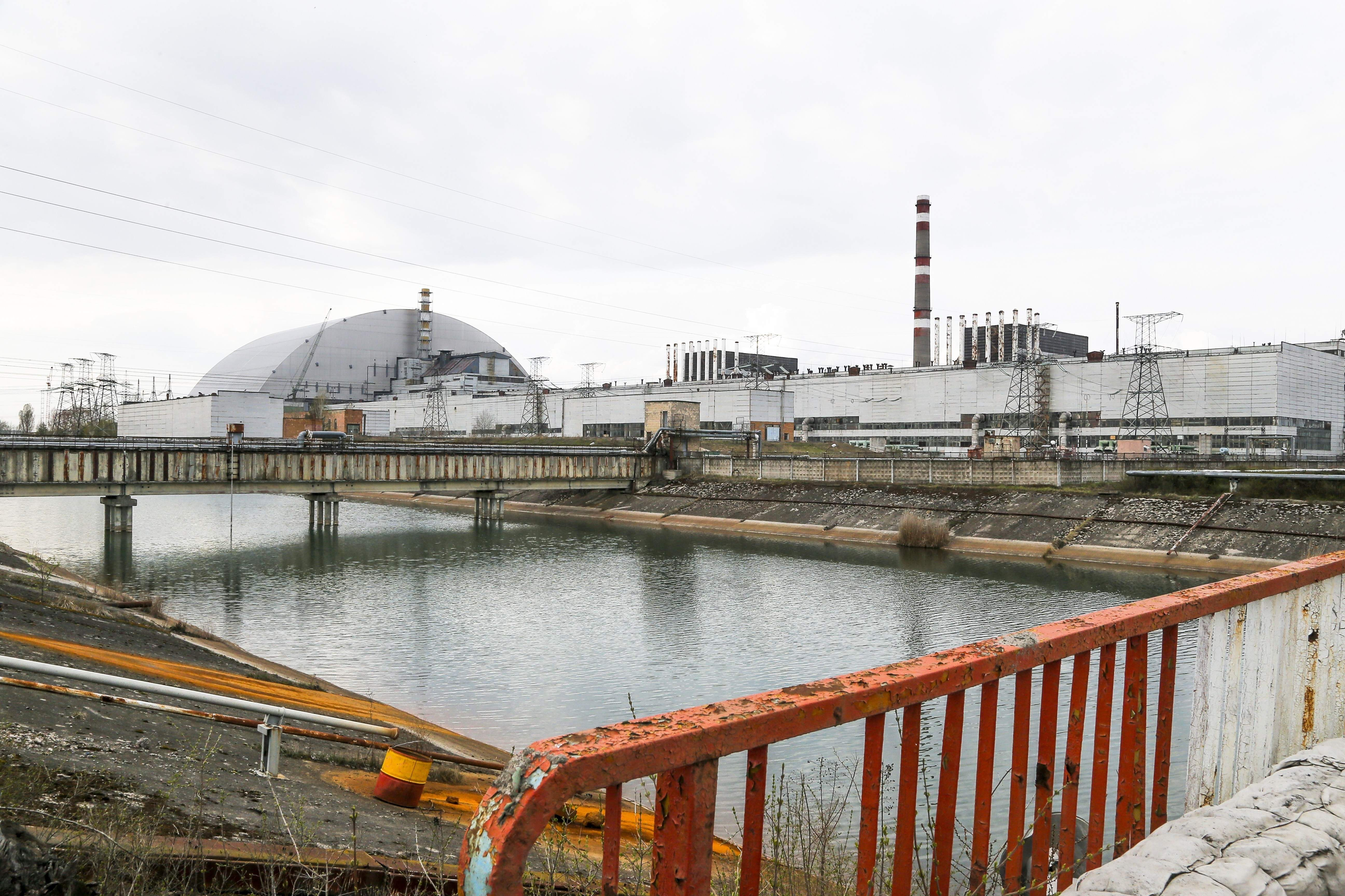 In this photo taken Wednesday, April 5, 2017, a new shelter is installed over the exploded reactor at the Chernobyl nuclear plant, in Chernobyl, Ukraine. April 26 marks the 31st anniversary of the Chernobyl nuclear disaster. A reactor at the Chernobyl nuclear power plant exploded on April 26, 1986, leading to an explosion and the subsequent fire spewed a radioactive plume over much of northern Europe. THE ASSOCIATED PRESS