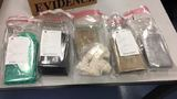 Police, DEA make arrests and seize heroin and cash in big bust