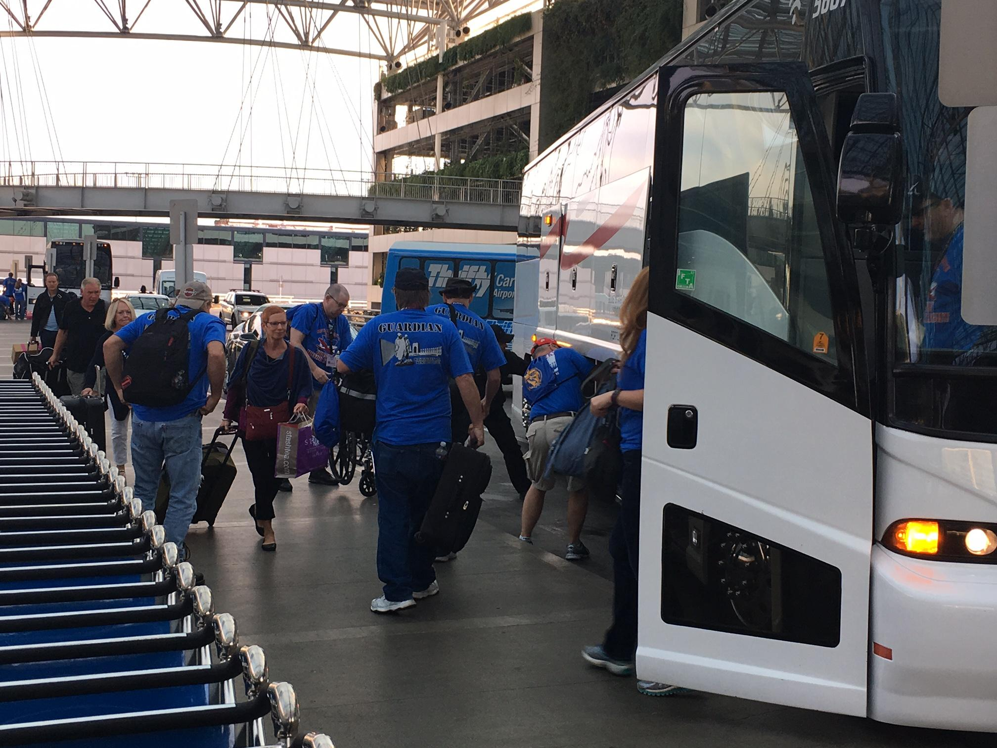 The veterans boarded buses en route to the Portland Airport, then flew to Reagan International in Washington, D.C., on Friday. (SBG)<p></p>