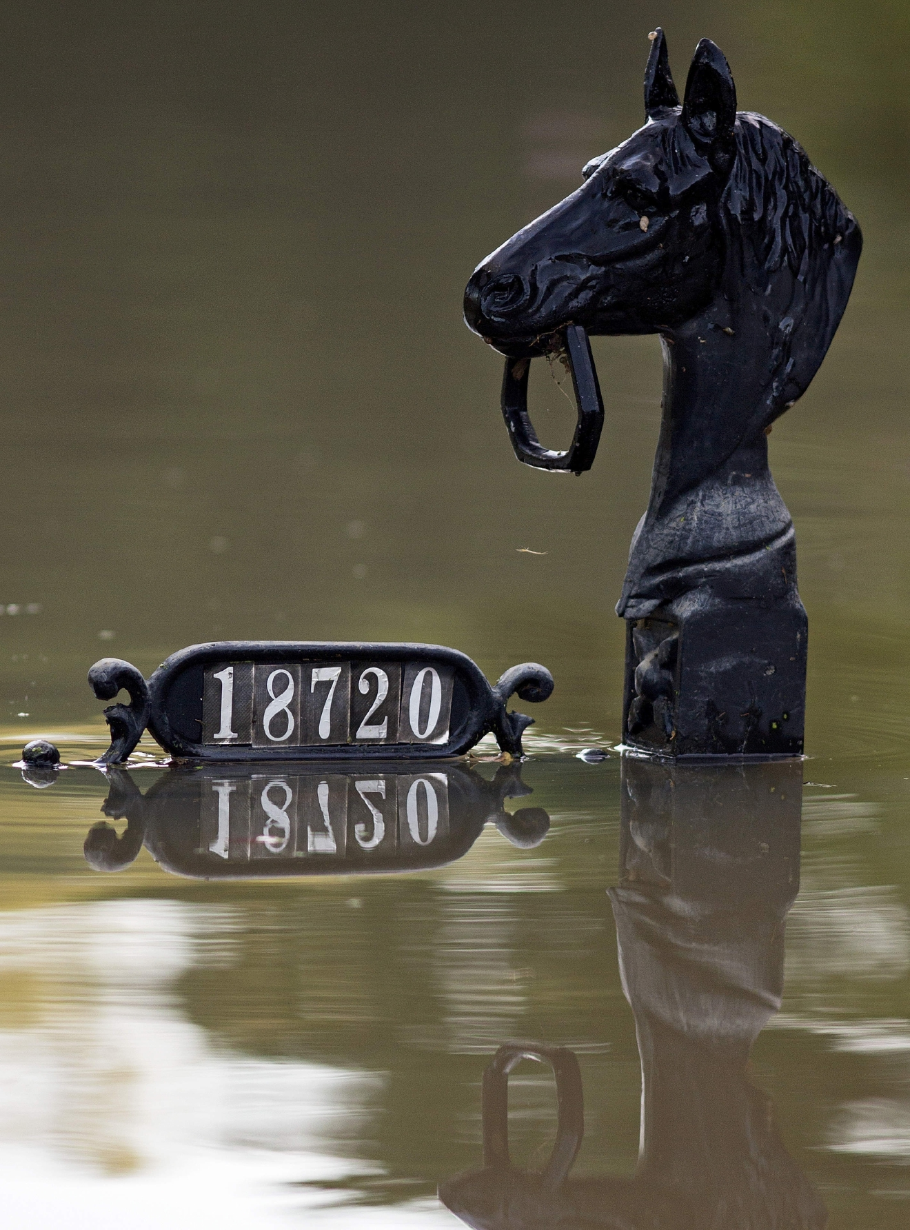 Mailboxes are seen just above flood water in Prairieville, La., Tuesday, Aug. 16, 2016.  As waters begin to recede in parts of Louisiana,  some residents struggled to return to flood-damaged homes on foot, in cars and by boat.  (AP Photo/Max Becherer)