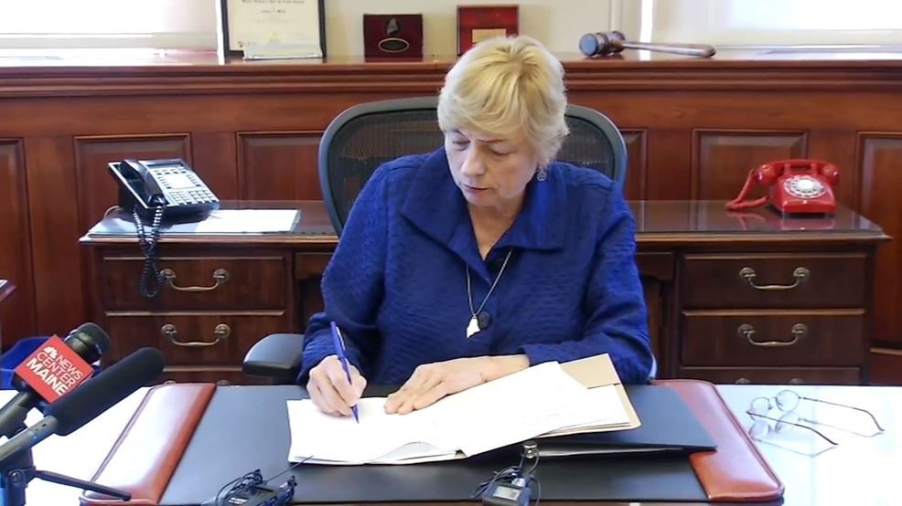 Gov. Mills signs bill to make public, private insurers cover abortions