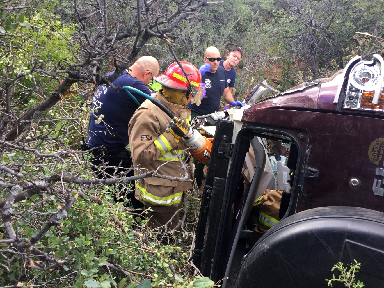 This Photo Provided By Kim Moore Shows Firefighters Working To Extricate A  50 Year