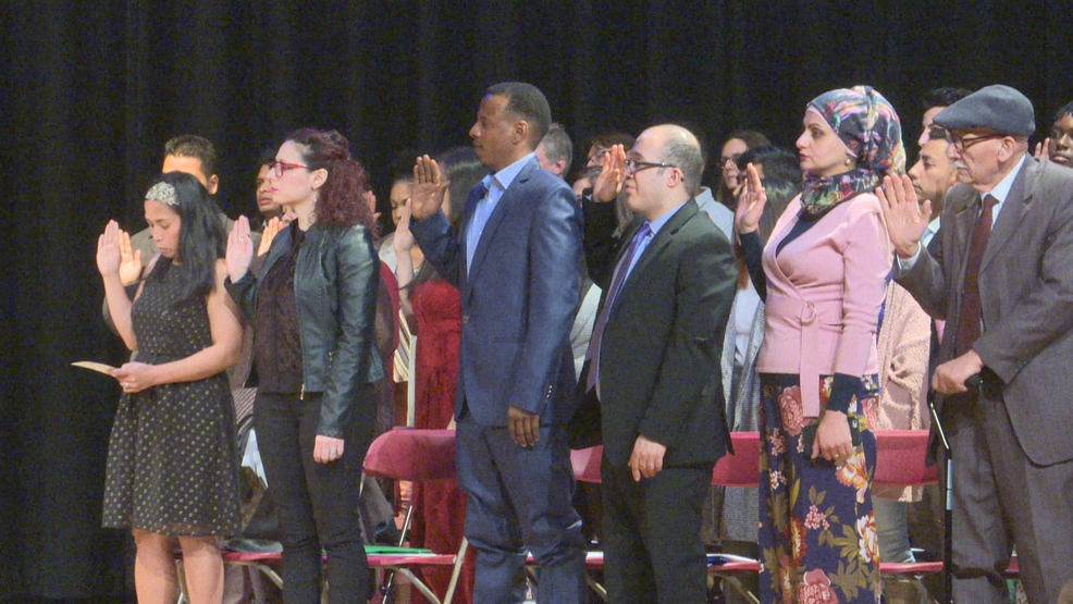 Syracuse welcomes 53 new citizens at naturalization ceremony