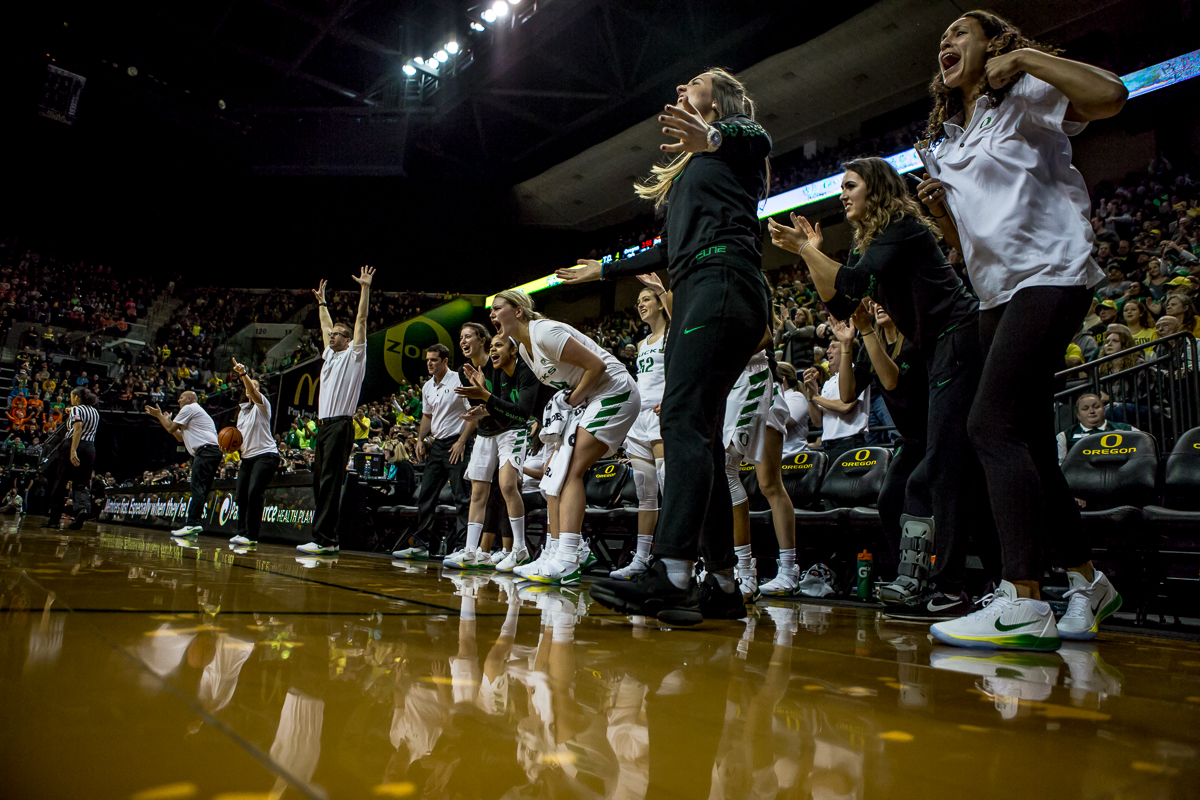 The Oregon bench yells and cheers to celebrate an Oregon basket. The Oregon Ducks defeated the Oregon State Beavers 75-63 on Sunday afternoon in front of a crowd of 7,249 at Matthew Knight Arena. The Ducks and Beavers split the two game Civil War with the Beavers defeating the Ducks on Friday night in Corvallis. The Ducks had four players in double digits: Satou Sabally with 21 points, Maite Cazorla with 16, Sabrina Ionescu with 15, and Mallory McGwire with 14. The Ducks shot 48.4% from the floor compared to the Beavers 37.3%. The Ducks are now 7-1 in conference play. Photo by Ben Lonergan, Oregon News Lab