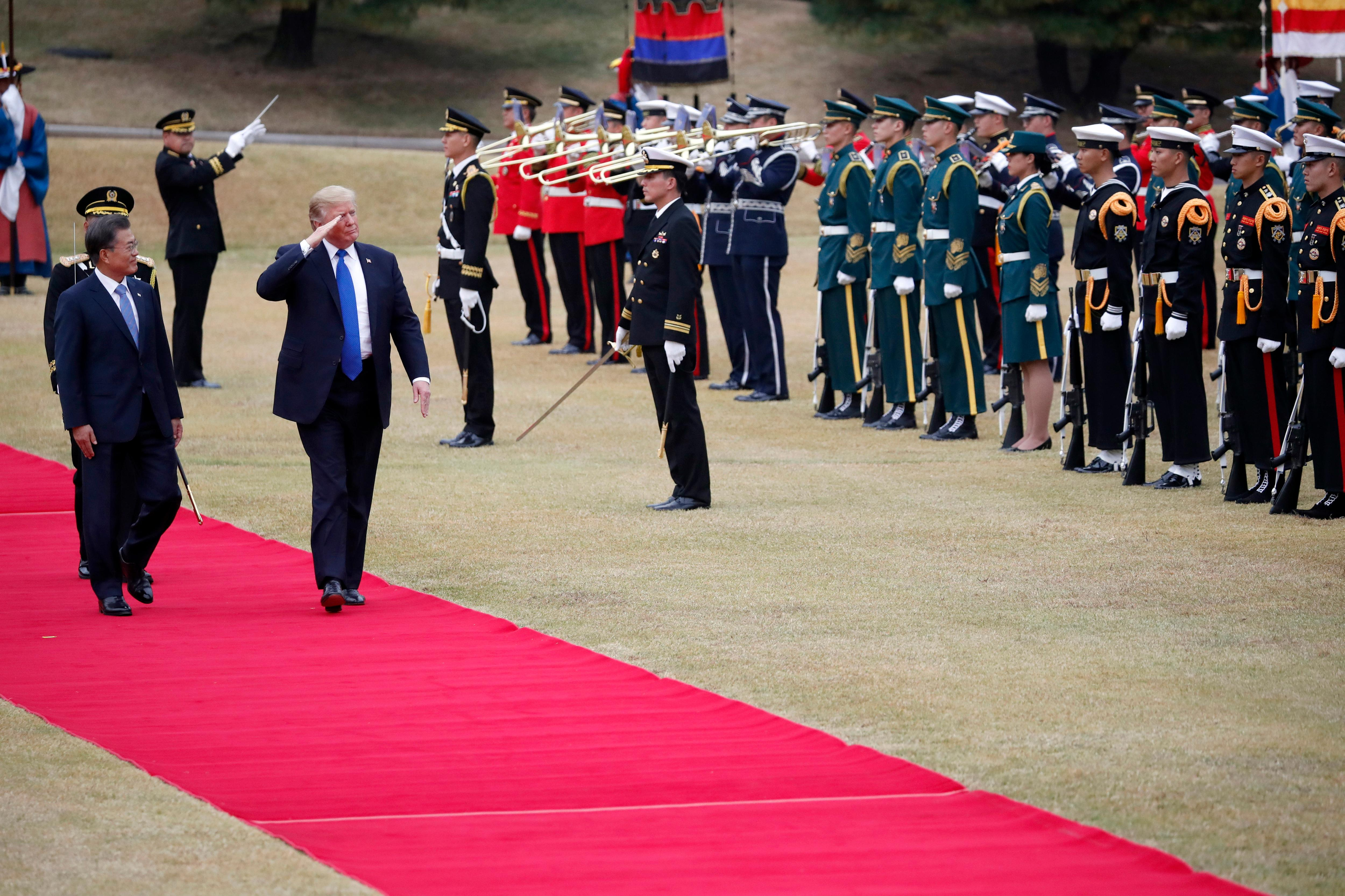 U.S. President Donald Trump, right on red carpet, walks with South Korea's President Moon Jae-in during a welcoming ceremony at the Presidential Blue House in Seoul Tuesday, Nov. 7, 2017. (Kim Hong-ji/Pool Photo via AP)
