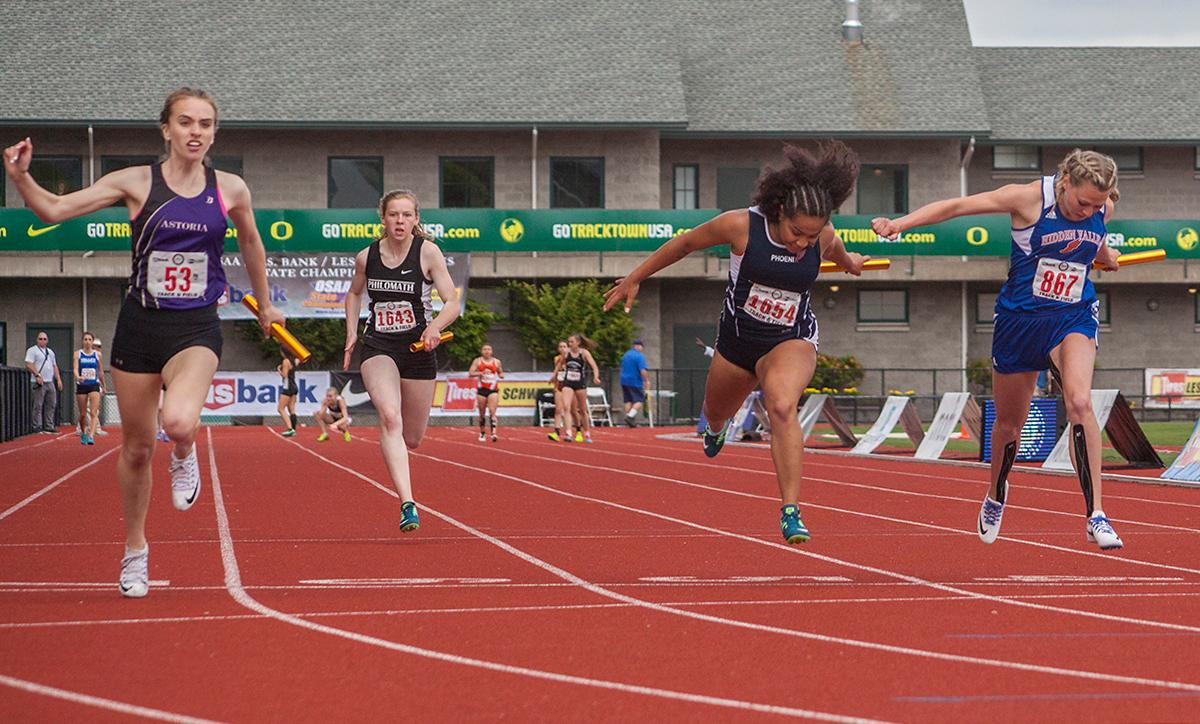 Gracie Cummings, Andrea Harris, Nara Van De Grift and Natalie Cummings from Astoria High School (left) wins the Girls 4x100 Meter Relay 4A event with the time of 49.77 at the OSAA Track and Field State Championships at Hayward Field. Photo by Vannie Cooper, Oregon News Lab