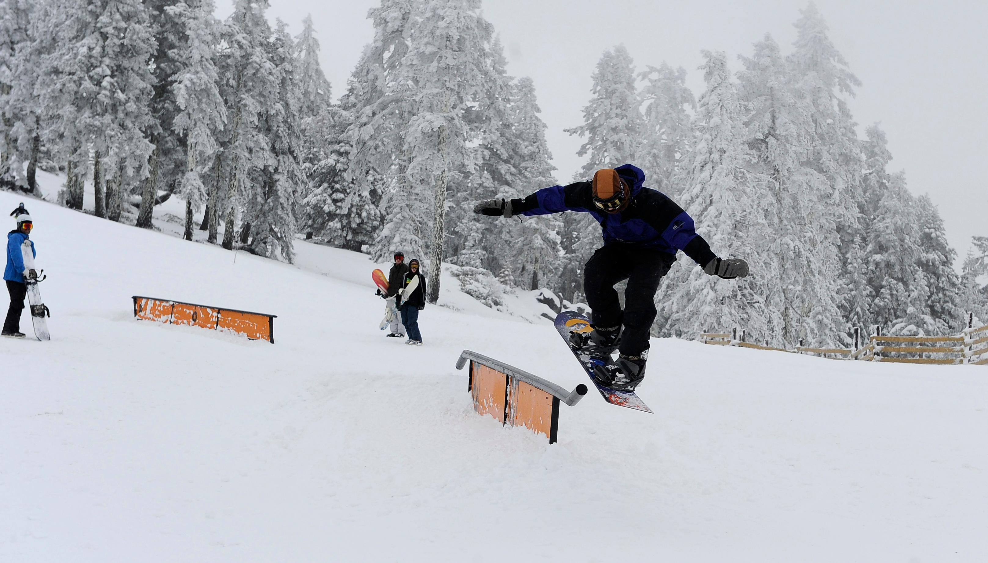Andy Atkinson / Mail Tribune <p>A snowboarder catches air off a rail during Mt. Ashland's Snow Stomp Saturday.</p>