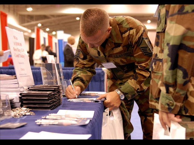 A veteran is shown at the Military Officers Association of America's biannual job fair in Washington, Photo Credit: Chris Maddalon