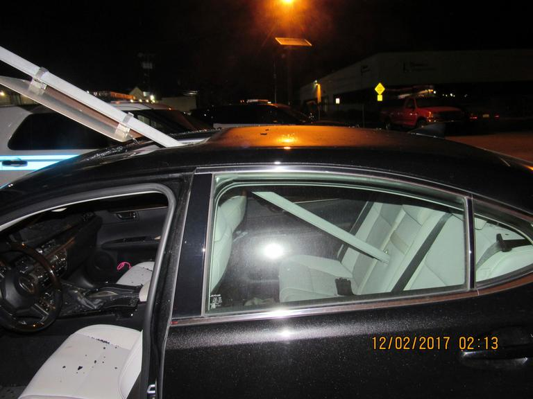A photo provided by the South Hackensack Police Department shows a car with a mass transit sign sticking out of the roof. New Jersey police say a woman was drunk when she continued driving with a mass transit sign sticking out of the roof of her car. The 52-year-old was pulled over Saturday, Dec. 2, 2017, on Route 46 in South Hackensack and has been charged with driving while intoxicated and careless driving. (South Hackensack Police Department via AP)