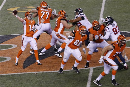 Cincinnati Bengals quarterback Andy Dalton (14) throws against the Houston Texans in the first half of an NFL football game in Cincinnati, Monday, Nov. 16, 2015.  (AP Photo/Frank Victores)
