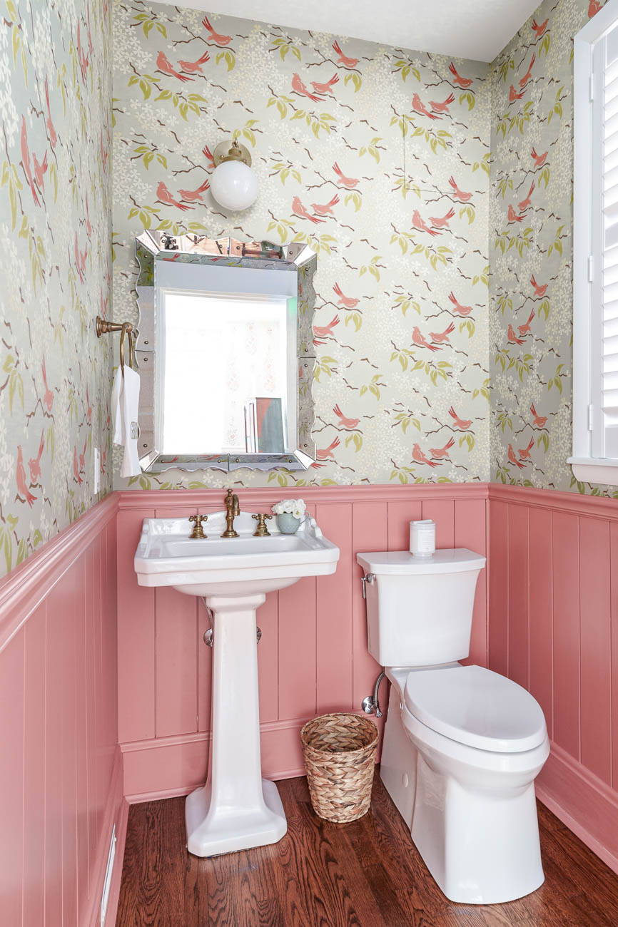 Reusch also redid the home's powder room and bathroom and true to form, they're gorgeous. A Laney Reusch design trademark is wallpaper that pops, and that is certainly true of these rooms. This client owns a floral shop, and her love of flowers comes through in the wallpaper choices here, as well as the color palettes. The vibrant floral print of the wallpaper in the bath against a backdrop of classic white tile makes the room a true showstopper. The bird-print wallpaper in the powder room is charming and enlivens this smaller space without being overpowering. / Image: Christopher Farr, courtesy of Reusch Interior Design // Published: 12.2.19