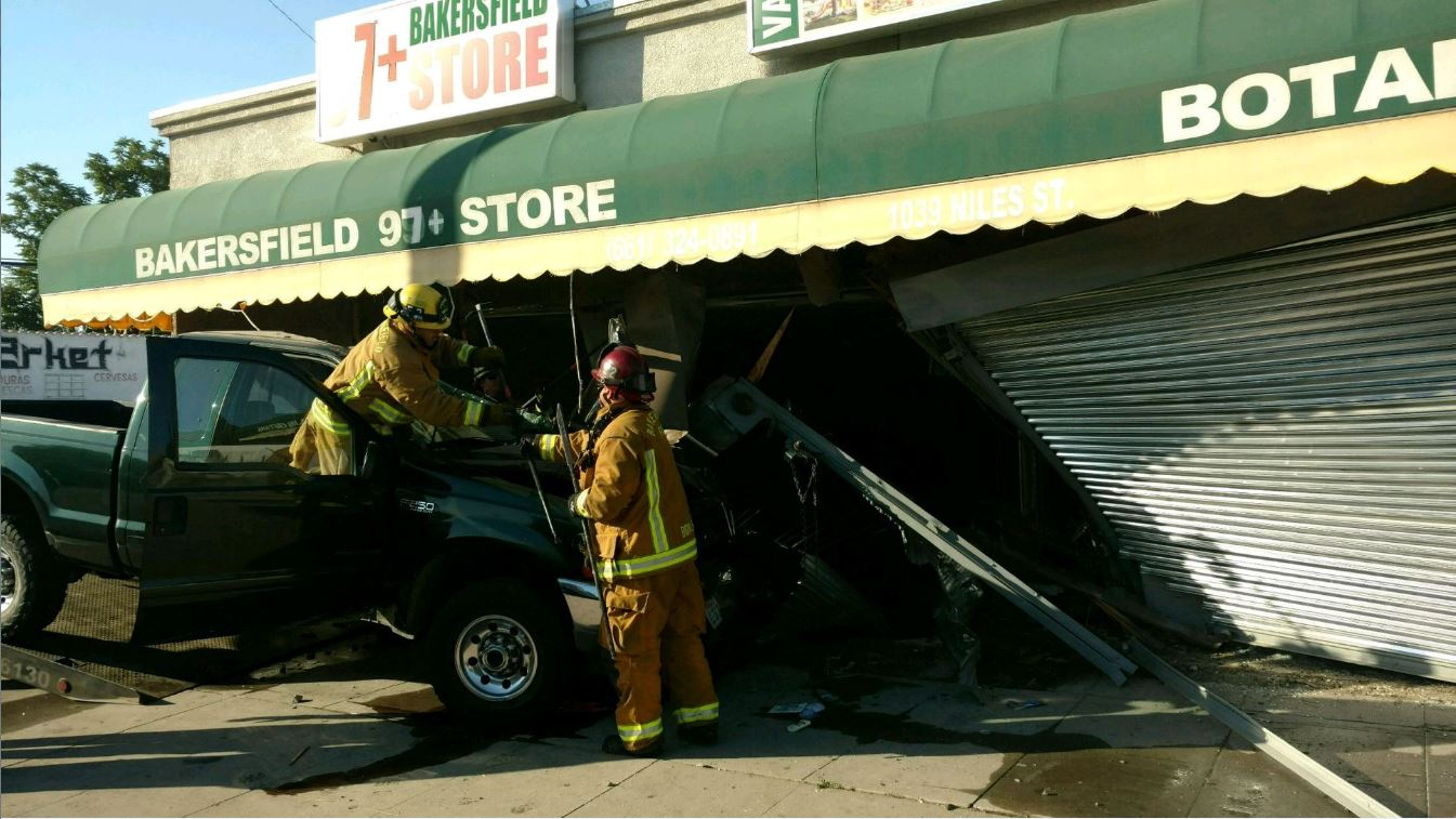 A truck is seen after crashing into a pair of businesses Thursday morning, June 15, 2017 at Niles and Gage streets in Bakersfield, Calif. (Photo from Bakersfield Fire Department)