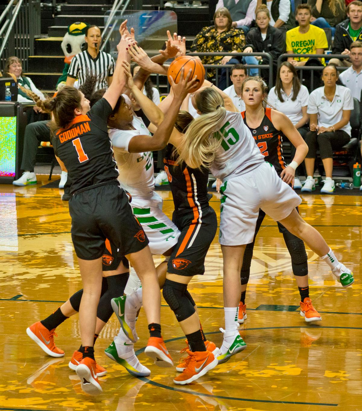 Oregon Ducks Ruthy Hebard (#24) fights to gain control of a rebound. The Oregon Ducks defeated the Oregon State Beavers 75-63 on Sunday afternoon in front of a crowd of 7,249 at Matthew Knight Arena. The Ducks and Beavers split the two game Civil War with the Beavers defeating the Ducks on Friday night in Corvallis. The Ducks had four players in double digits: Satou Sabally with 21 points, Maite Cazorla with 16, Sabrina Ionescu with 15, and Mallory McGwire with 14. The Ducks shot 48.4% from the floor compared to the Beavers 37.3%. The Ducks are now 7-1 in conference play. Photo by Dan Morrison, Oregon News Lab
