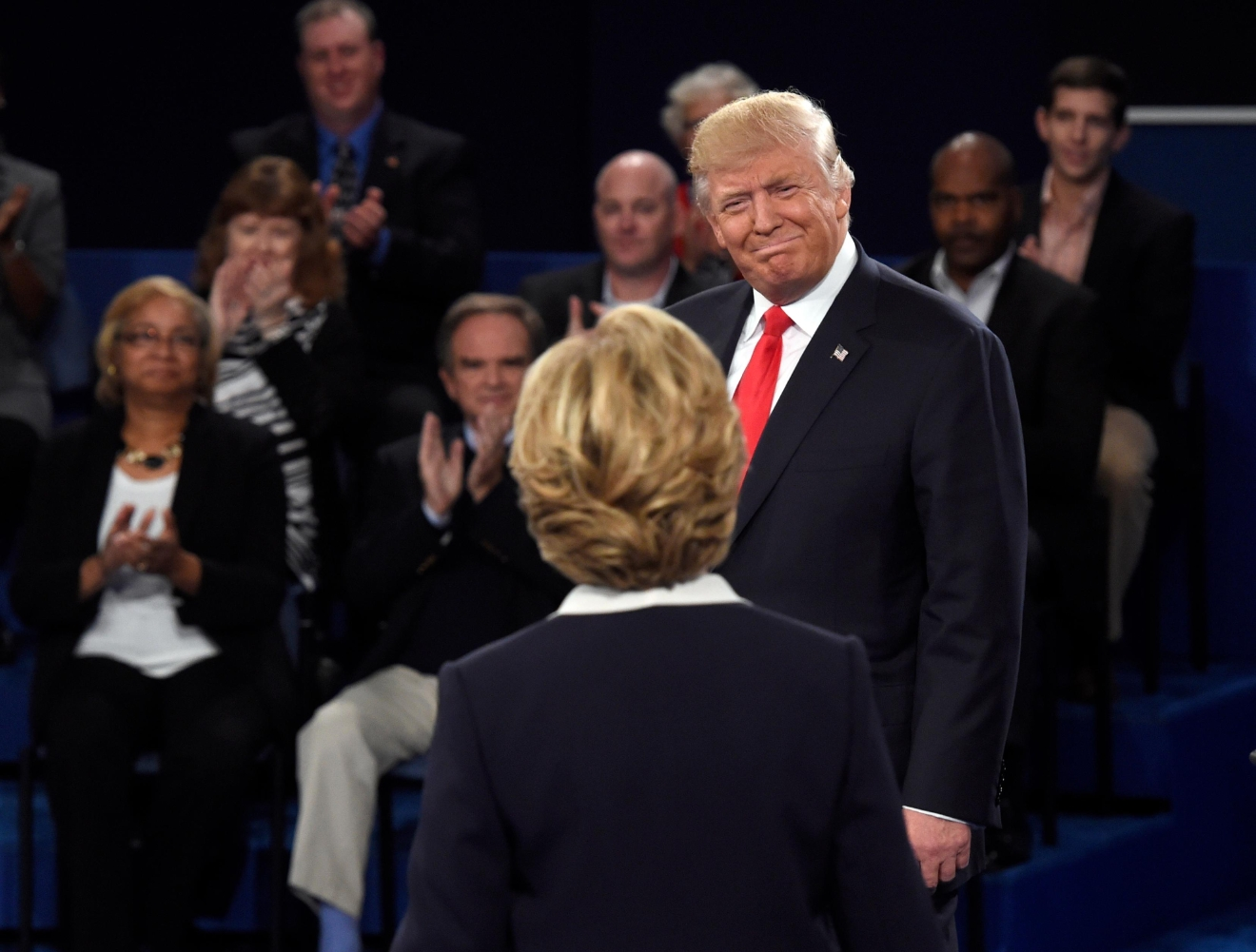 Republican presidential nominee Donald Trump, right, greets  Democratic presidential nominee Hillary Clinton before the second presidential debate at Washington University in St. Louis, Sunday, Oct. 9, 2016. (Saul Loeb/Pool via AP)