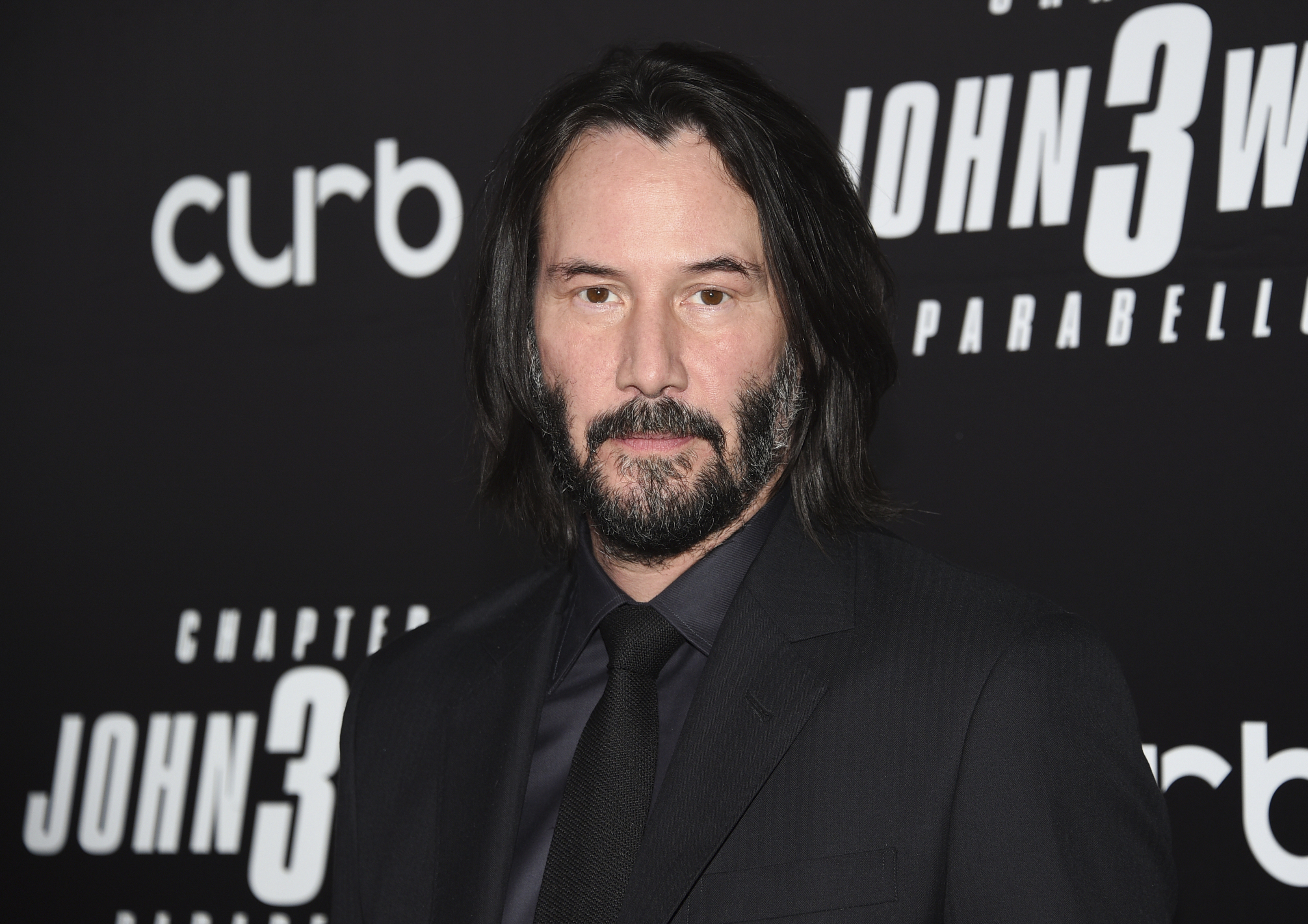 "FILE - In this May 9, 2019 file photo, actor Keanu Reeves attends the world premiere of ""John Wick: Chapter 3 - Parabellum"" at One Hanson in New York. Reeves and Lana Wachowski are returning to the world of ""The Matrix.""{ } (Photo by Evan Agostini/Invision/AP, File)"