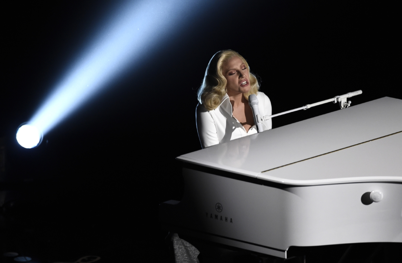 "Lady Gaga performs ""Til It Happens To You"" that is nominated for best original song from ""The Hunting Ground"" at the Oscars on Sunday, Feb. 28, 2016, at the Dolby Theatre in Los Angeles. (Photo by Chris Pizzello/Invision/AP)"