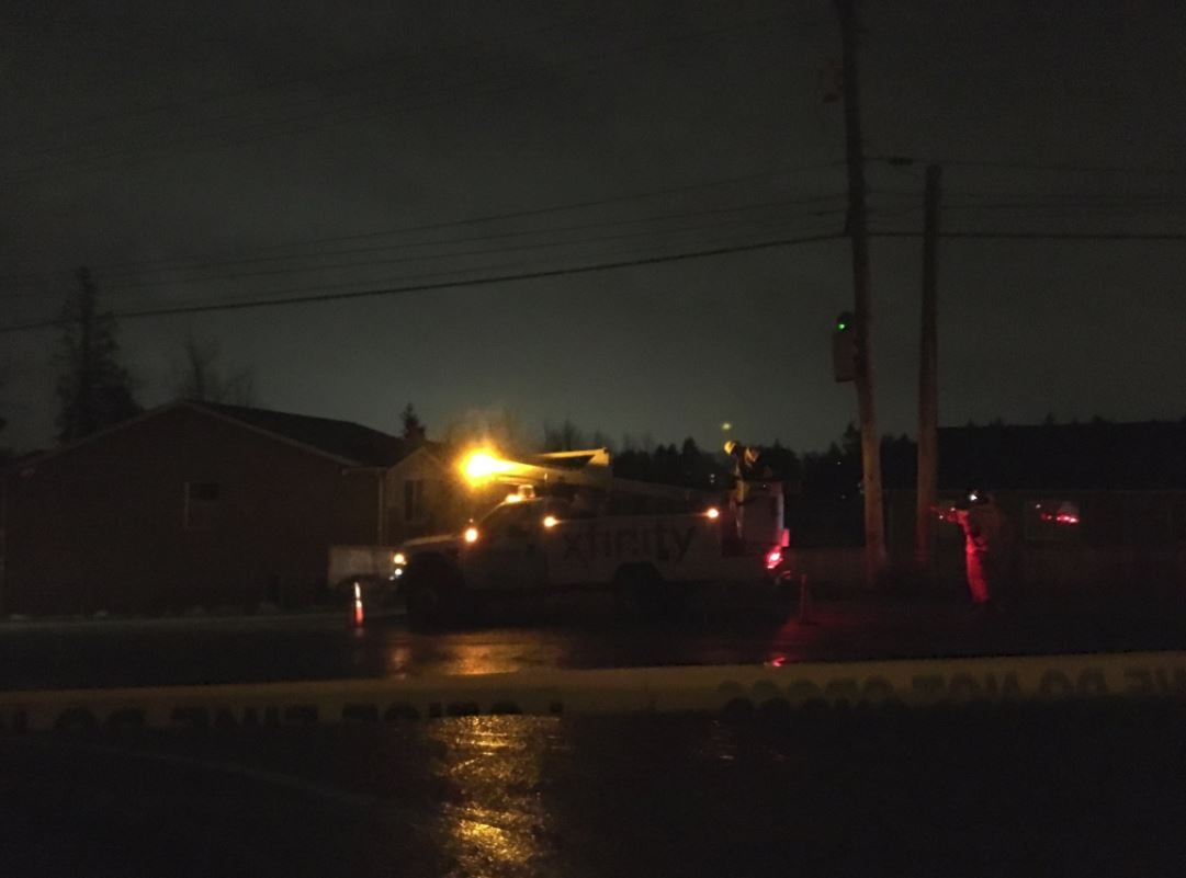 Trees plummeted onto power lines on Military Rd. S. and S. Reith Rd., shutting down a main section of the street and leaving hundreds of neighbors in the dark Thursday night, March 8, 2018. (Photo: KOMO News)