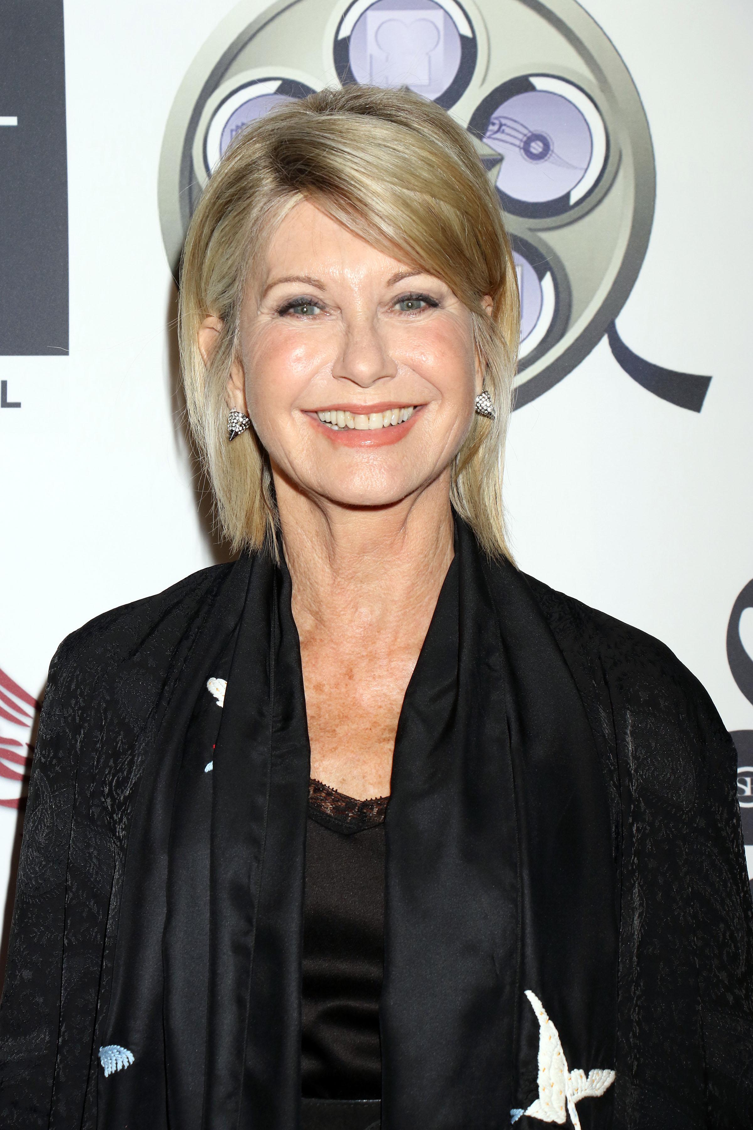 Olivia Newton-John says she has breast cancer; cancels ... Olivia Newton John