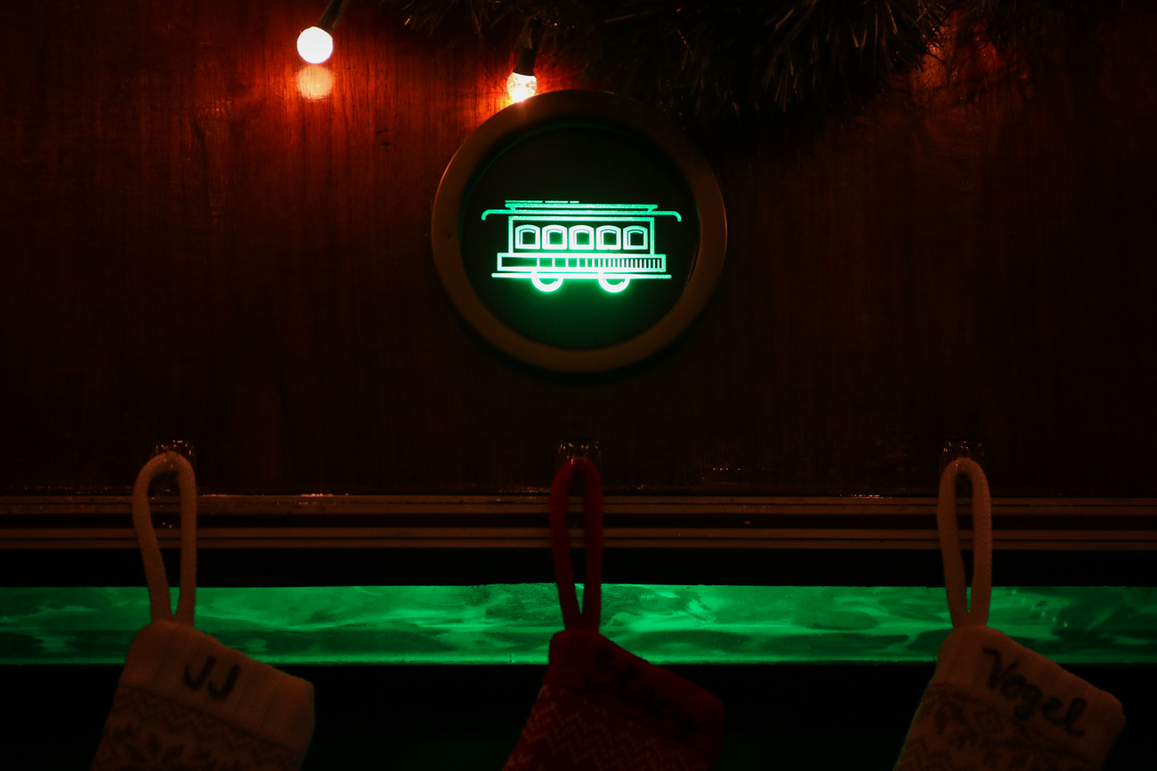 When a Downtown-bound streetcar is six minutes away from reaching the nearby 12th/Race Street Station, lighting above the bar changes to blue (green during the holidays) to alert patrons. This offers visitors the chance to pay their tab and time their exit directly with the streetcar's arrival. / Image: Ronny Salerno // Published: 1.2.19