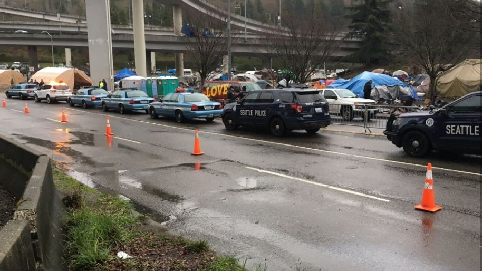 Seattle homeless the field sweep SPD cars.JPG
