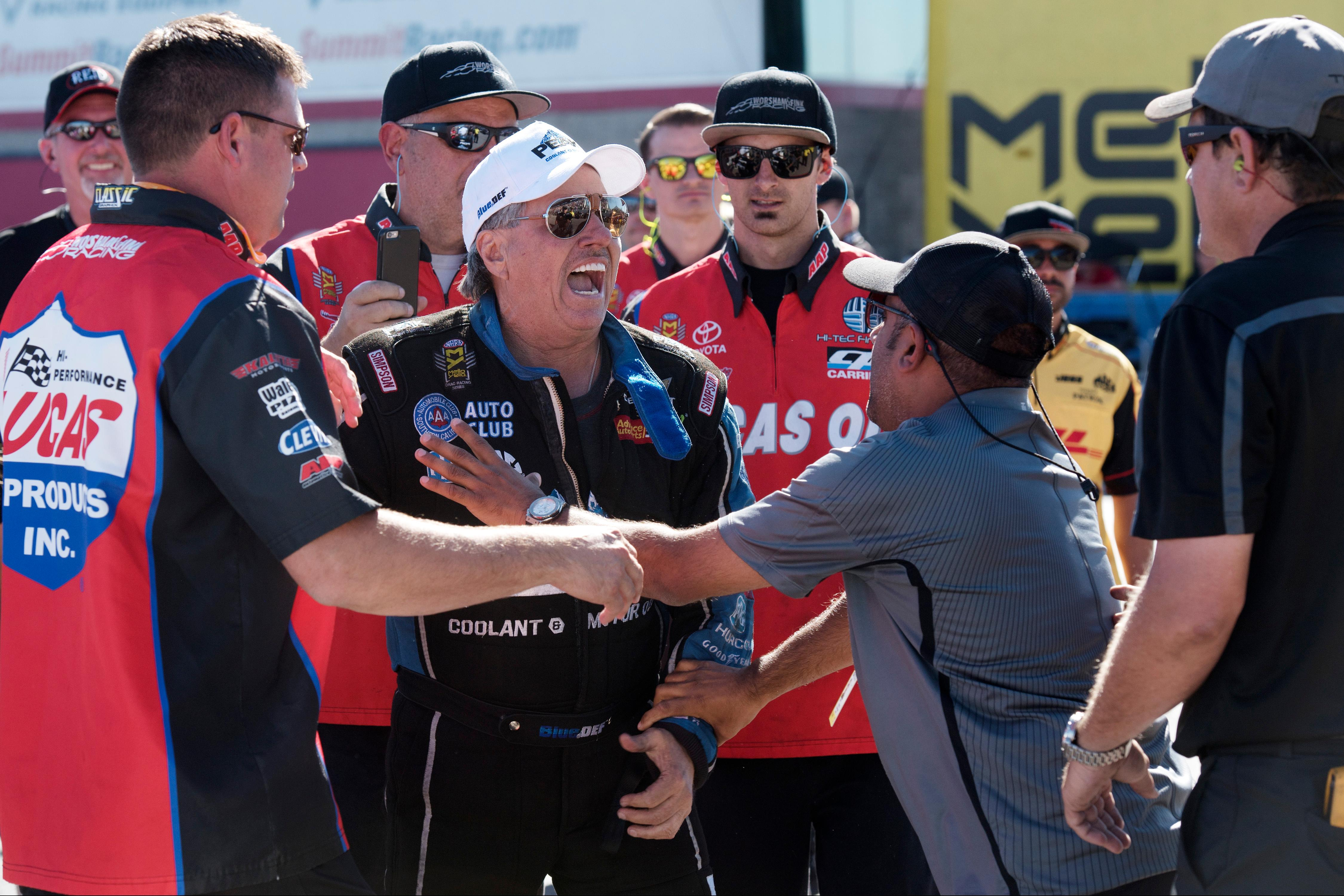 Funny Car driver and team owner John Force gets in a heated exchange with Funny Car driver Chad Head during the NHRA Toyota Nationals Sunday, October 29, 2017, at The Strip at the Las Vegas Motor Speedway. CREDIT: Sam Morris/Las Vegas News Bureau