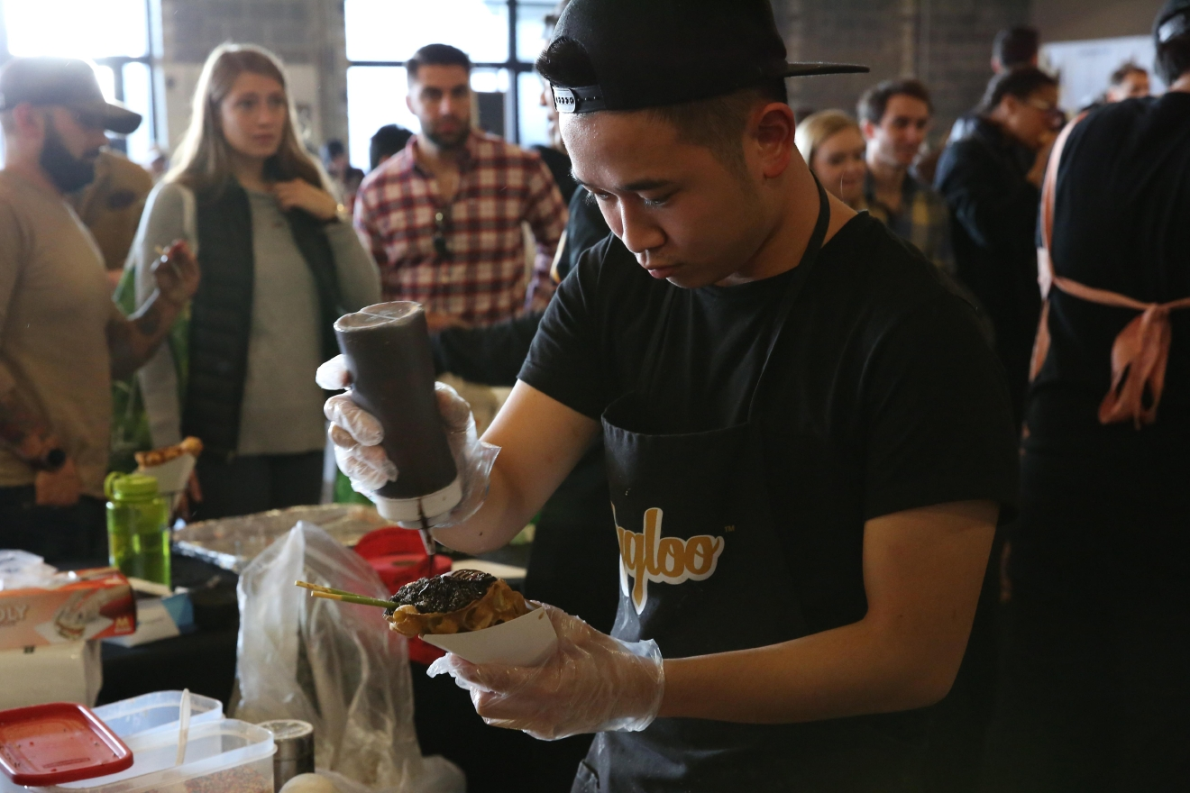 Hundreds of people flooded into Union Market over the weekend for The Emporiyum, where vendors offer samples and fare ranging from Hong Kong desserts to locally crafted cocktails. (Amanda Andrade-Rhoades/DC Refined)