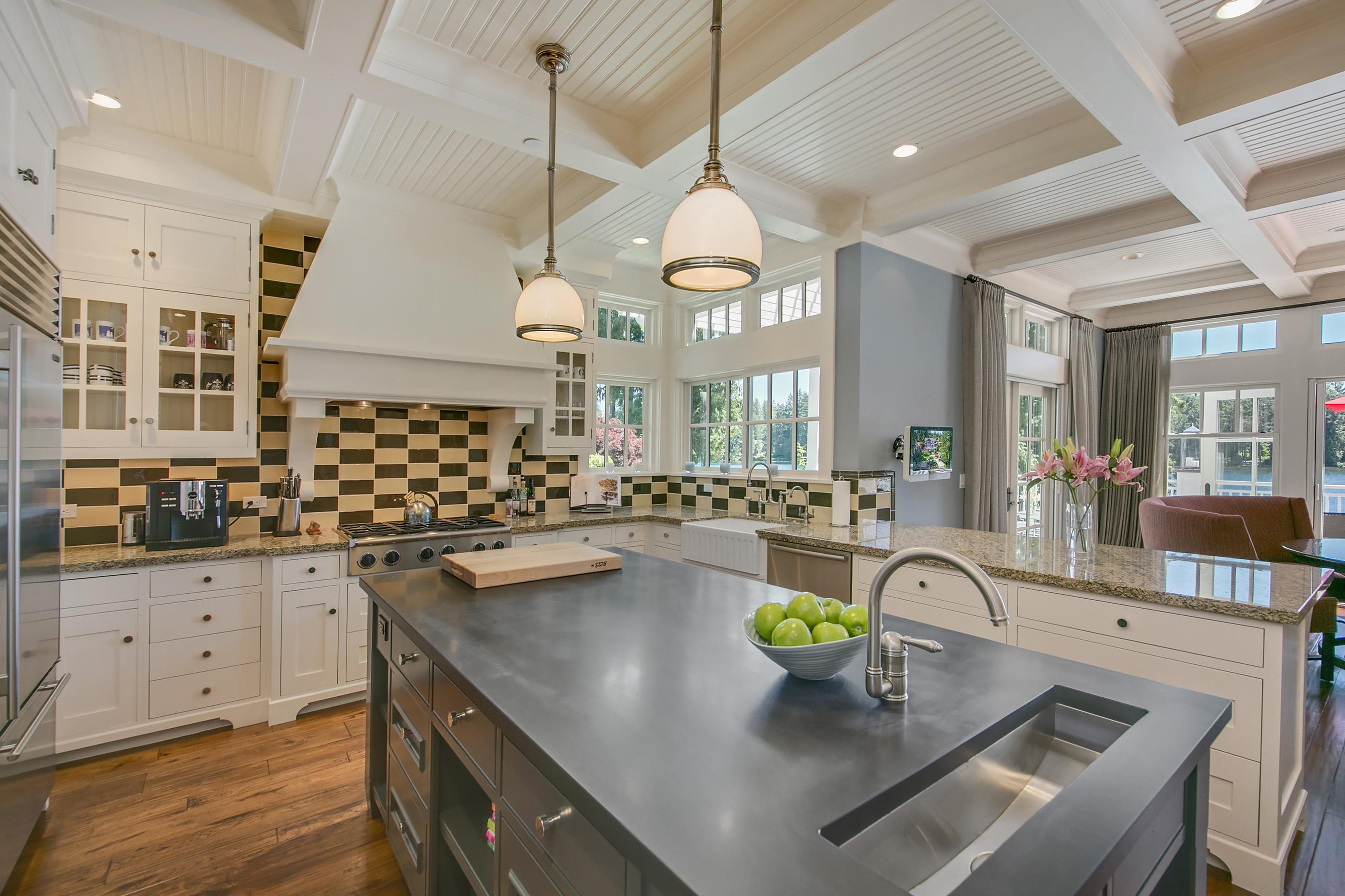 Somehow, the kitchen features dual sinks, dual ovens, granite counters and a six-range gas stove without seeming the tiniest bit imposing.