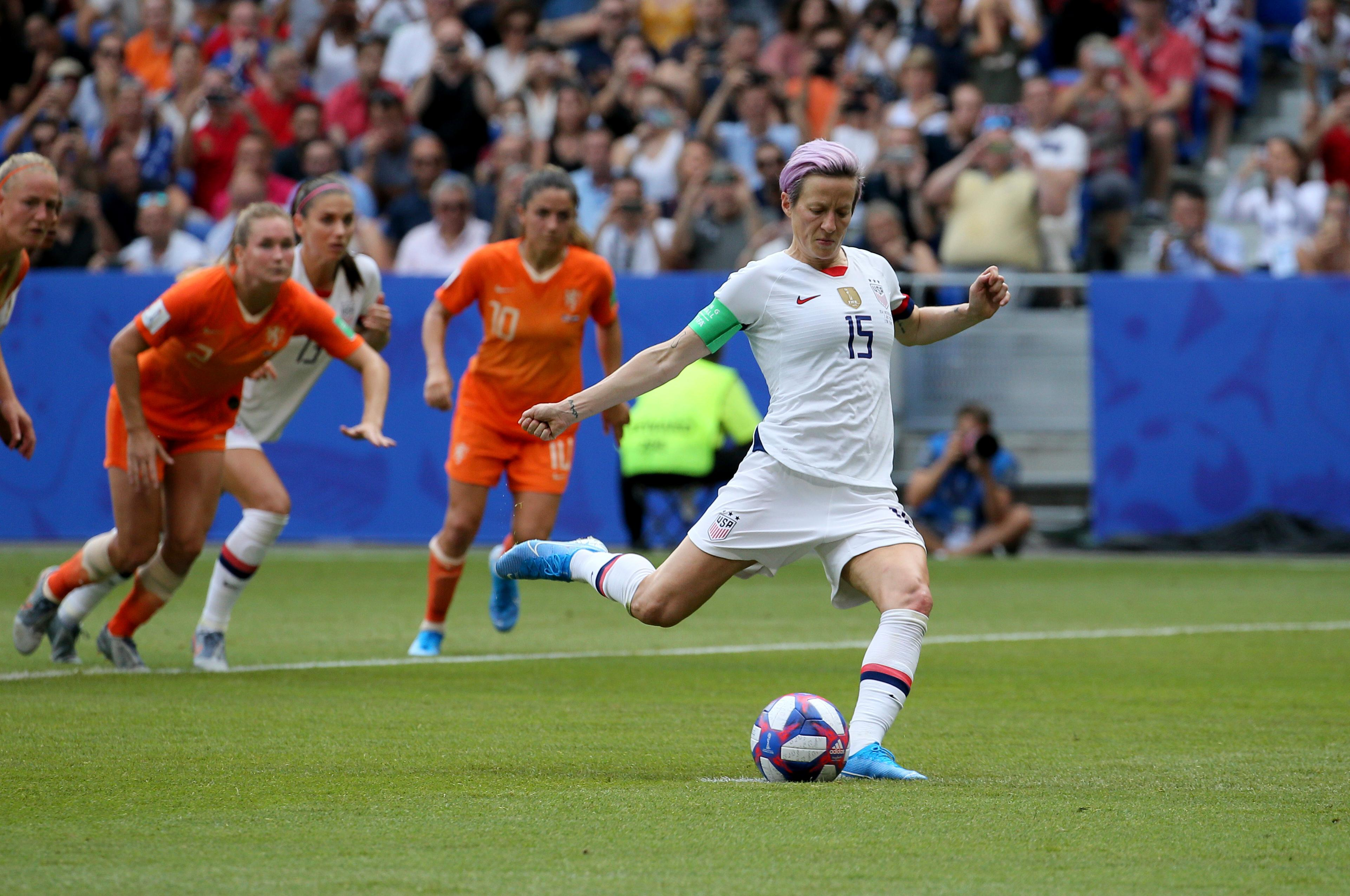 United States' Megan Rapinoe scores her side's opening goal from a penalty shot during the Women's World Cup final soccer match between US and The Netherlands at the Stade de Lyon in Decines, outside Lyon, France, Sunday, July 7, 2019. (AP Photo/David Vincent)