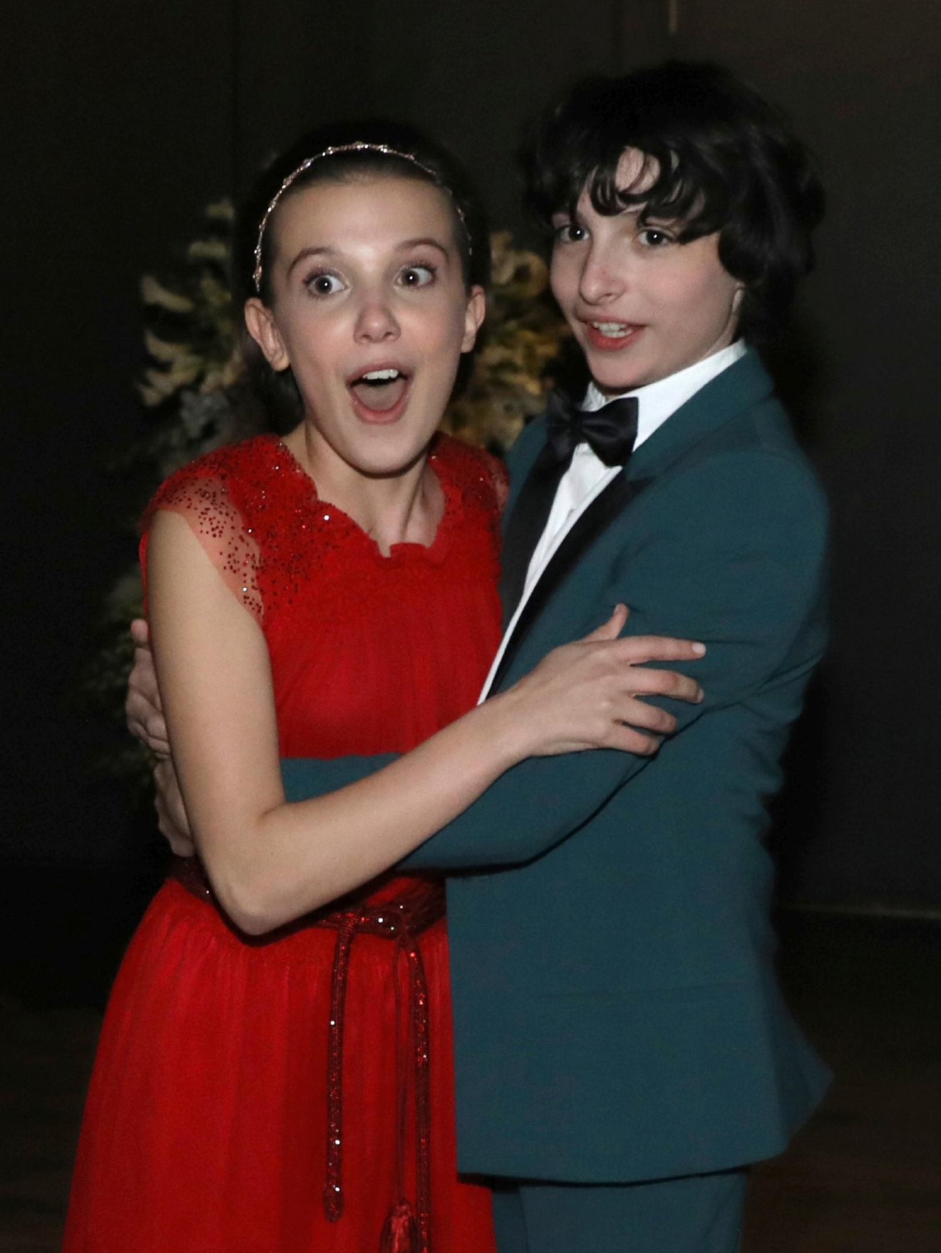 "Millie Bobby Brown, left, and Finn Wolfhard appear backstage after winning the award for outstanding performance by an ensemble in a drama series for ""Stranger Things"" at the 23rd annual Screen Actors Guild Awards at the Shrine Auditorium & Expo Hall on Sunday, Jan. 29, 2017, in Los Angeles. (Photo by Matt Sayles/Invision/AP)"
