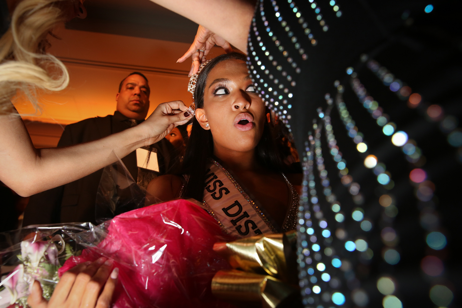 The newly crowned Miss D.C. USA, Bryce Armstrong, has her tiara adjusted before her first official photos. (Amanda Andrade-Rhoades/DC Refined)