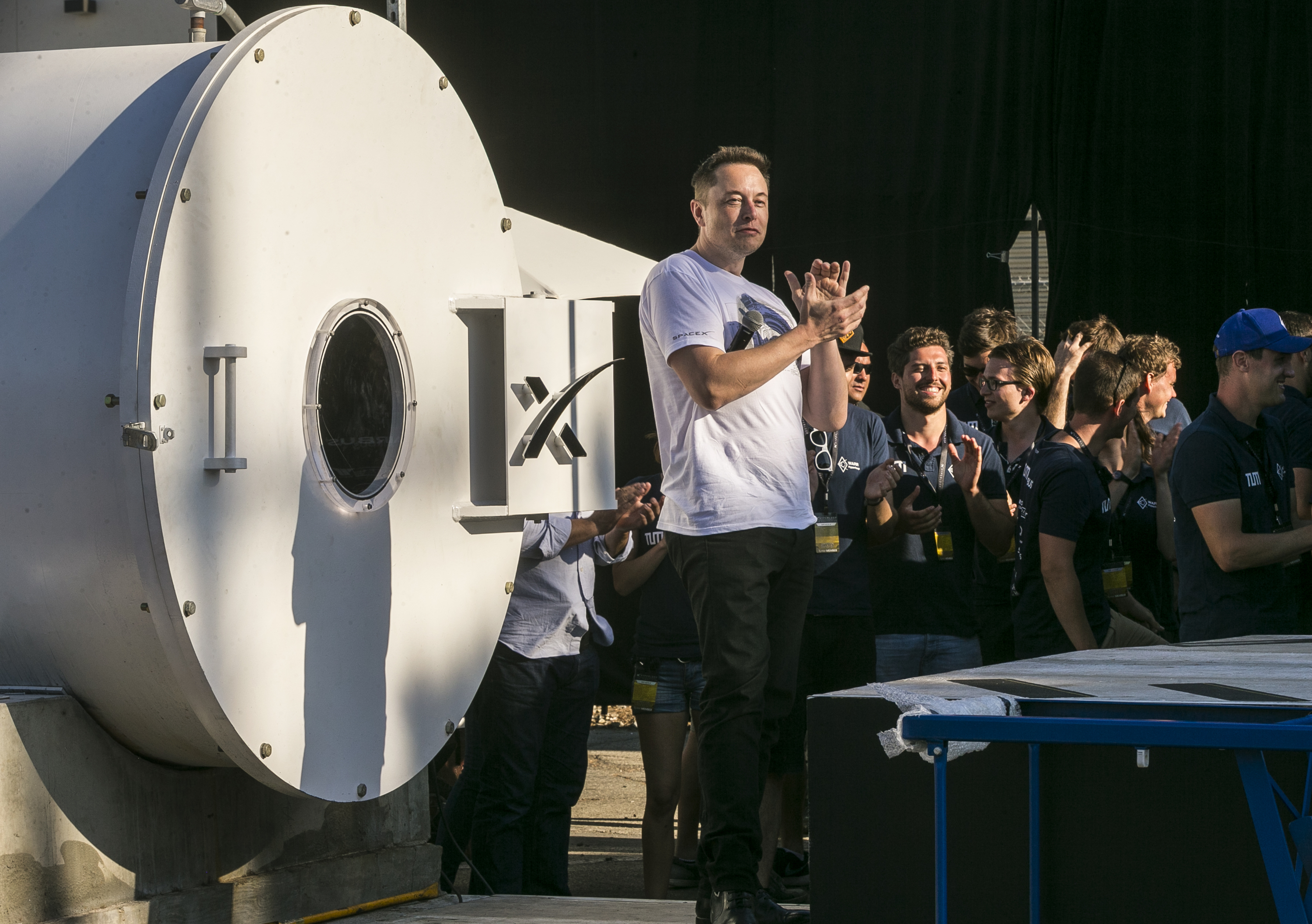 SpaceX CEO Elon Musk congratulates the winning team of the Hyperloop Pod Competition II at SpaceX's Hyperloop track in Hawthorne, Calif., Sunday, Aug. 27, 2017. The Hyperloop system built by SpaceX is approximately one mile in length with a six-foot outer diameter. The WARR team from Tech University Munich won the Hyperloop Pod Competition II with a peak speed of 324 kilometers per hour (201 mph). (AP Photo/Damian Dovarganes)