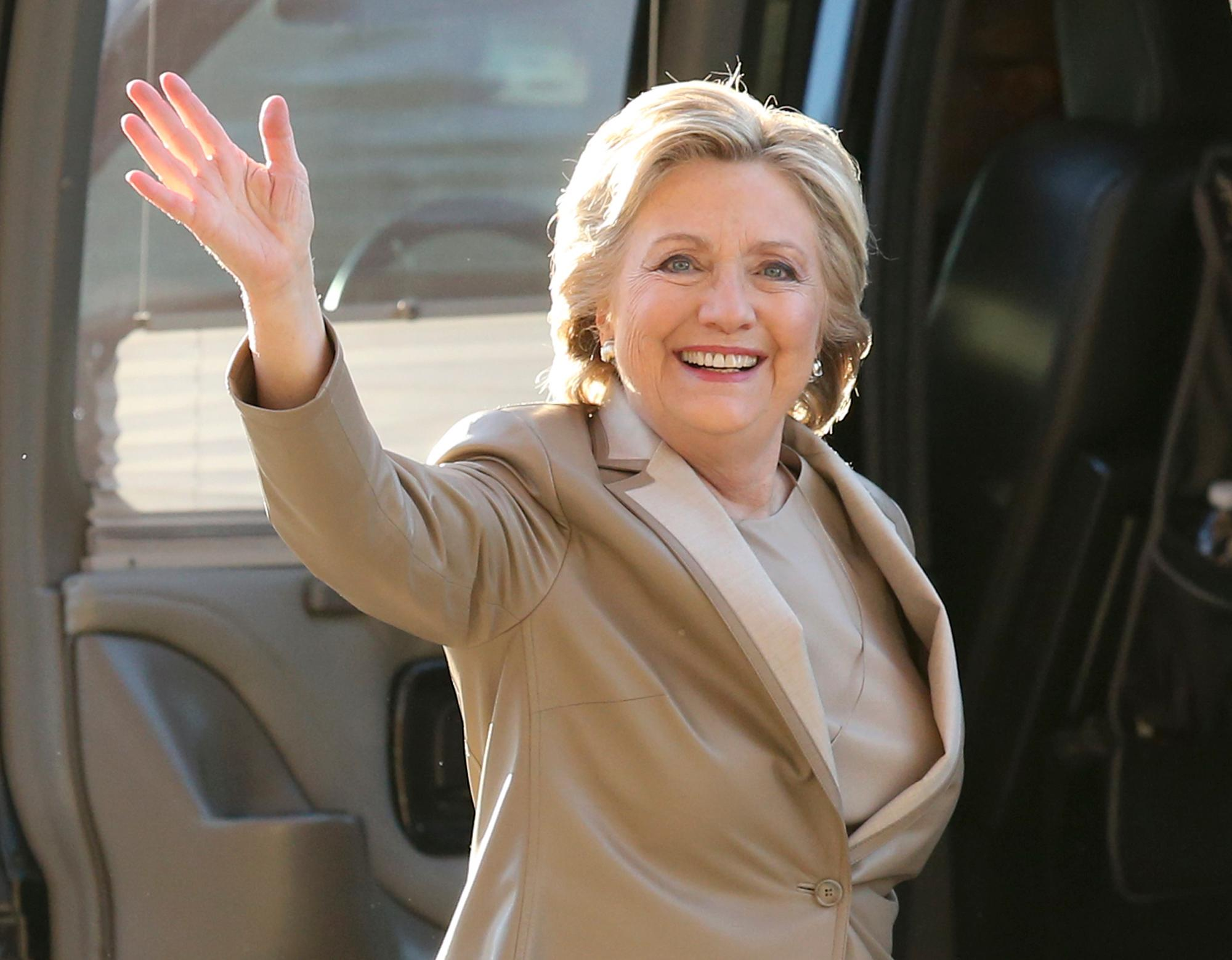 FILE - In this Nov. 8, 2016 file photo, Democratic presidential candidate Hillary Clinton waves as she arrives to vote at her polling place in Chappaqua, N.Y.{ } (AP Photo/Seth Wenig, File)